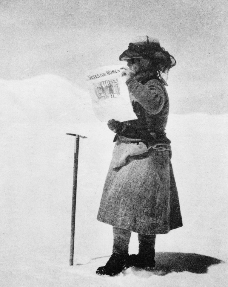 Ms.Fanny Bullock atop Pinnacle with a Poster calling for Woman to be allowed to Vote (Pic Courtesy Wikipedia)