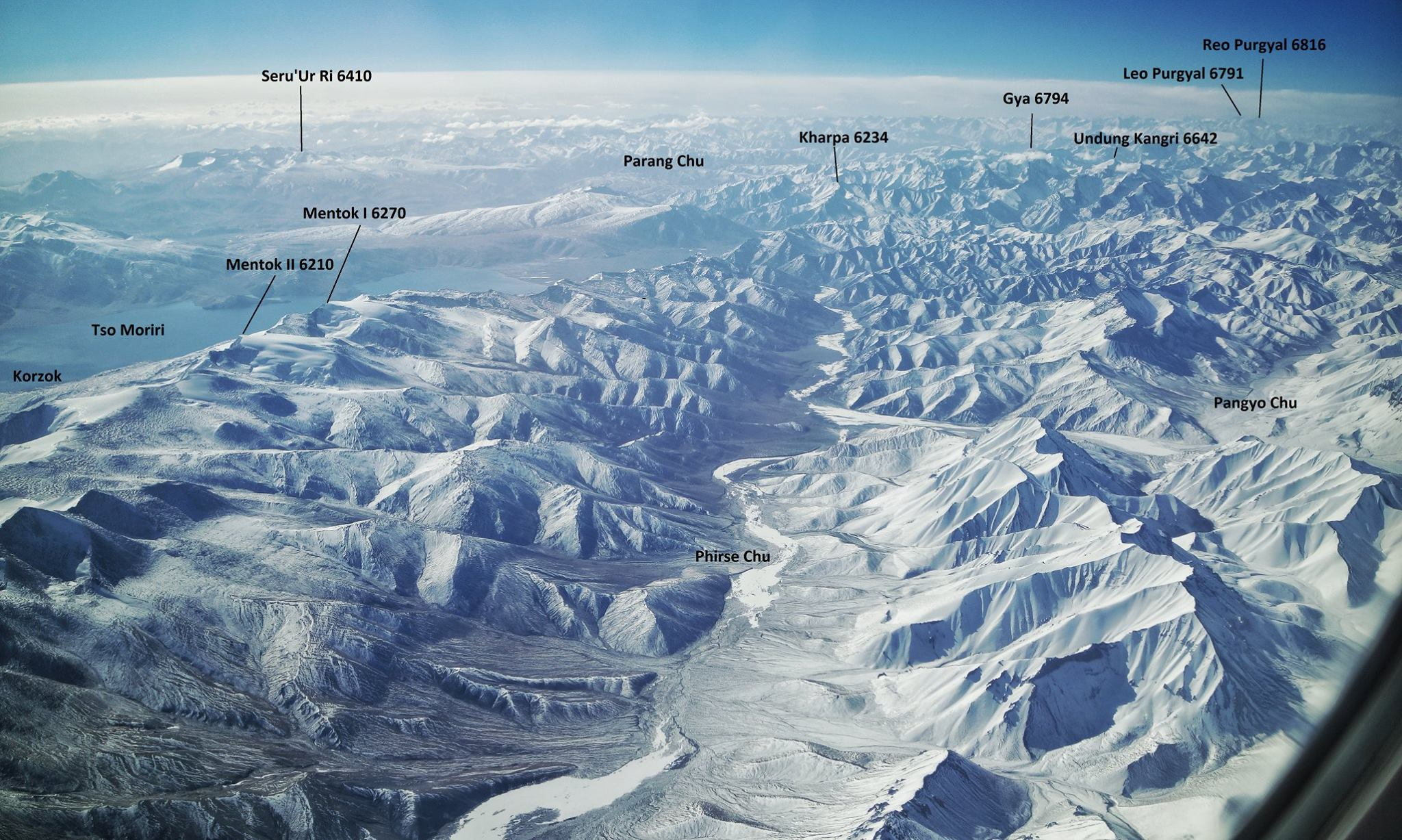 The transition between the Great Himalayan Range and the Zanskar Range as seen from a flight.