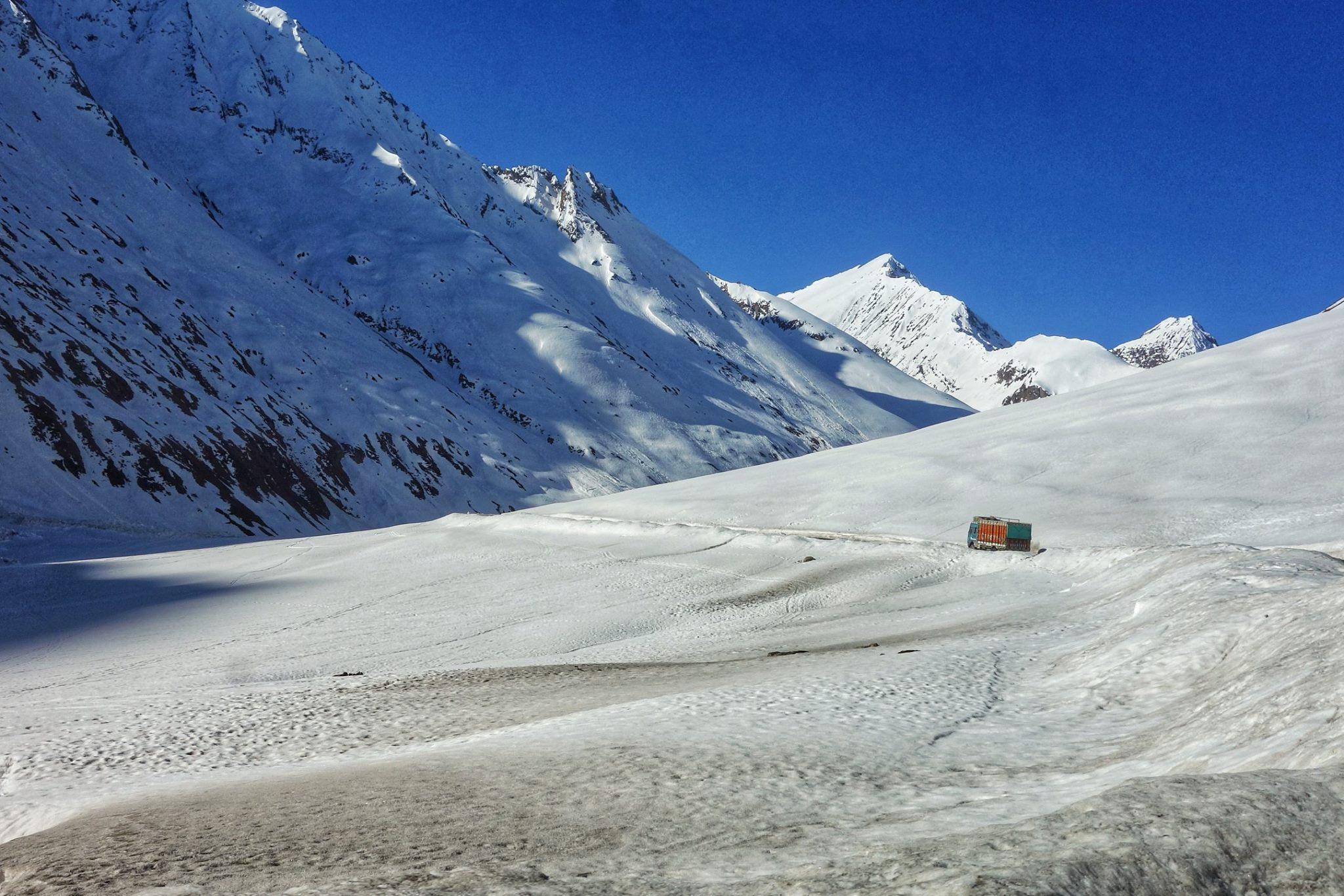 A Truck astride the Great Himalayan Range as it approaches Zoji La.