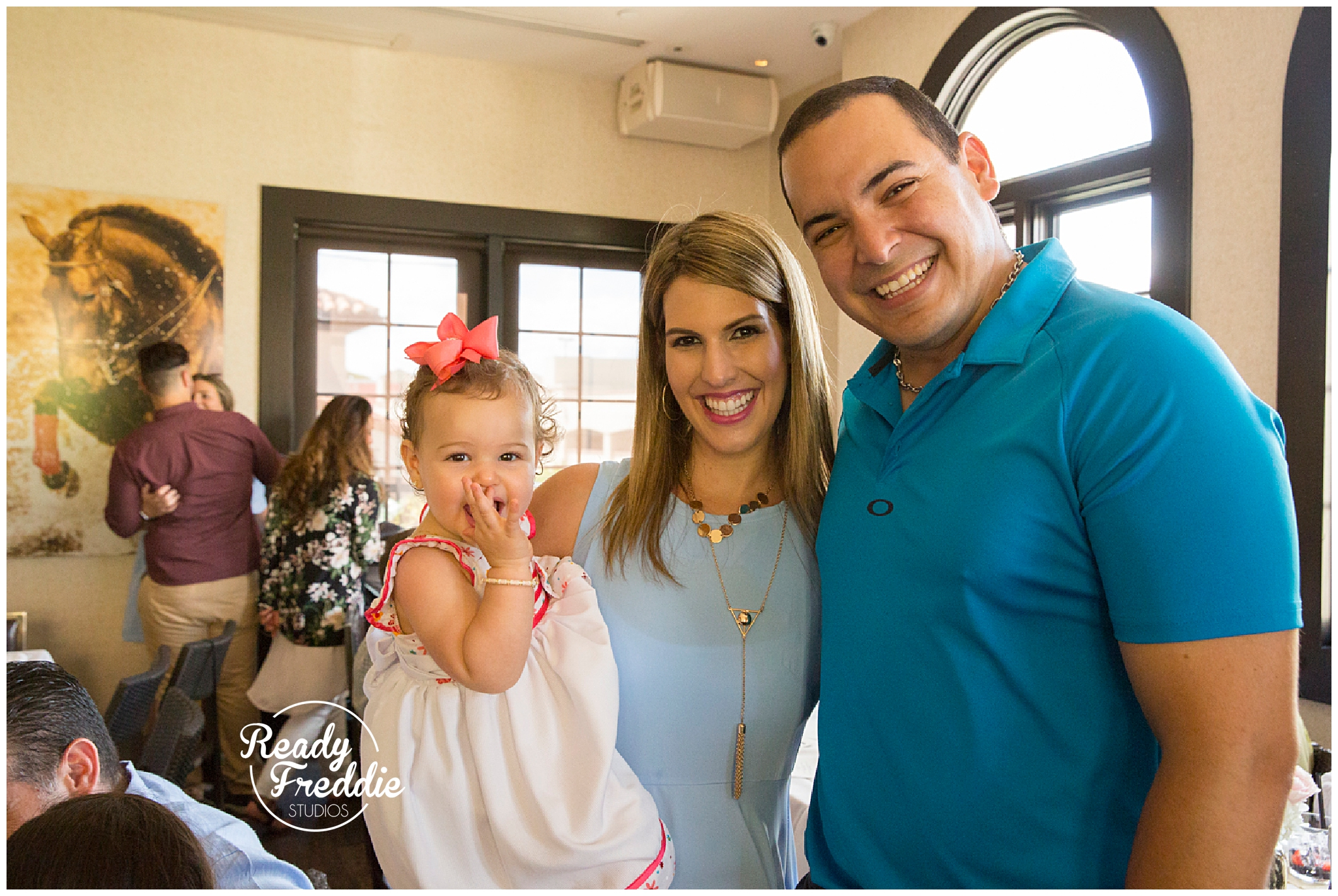 family poses in baby shower