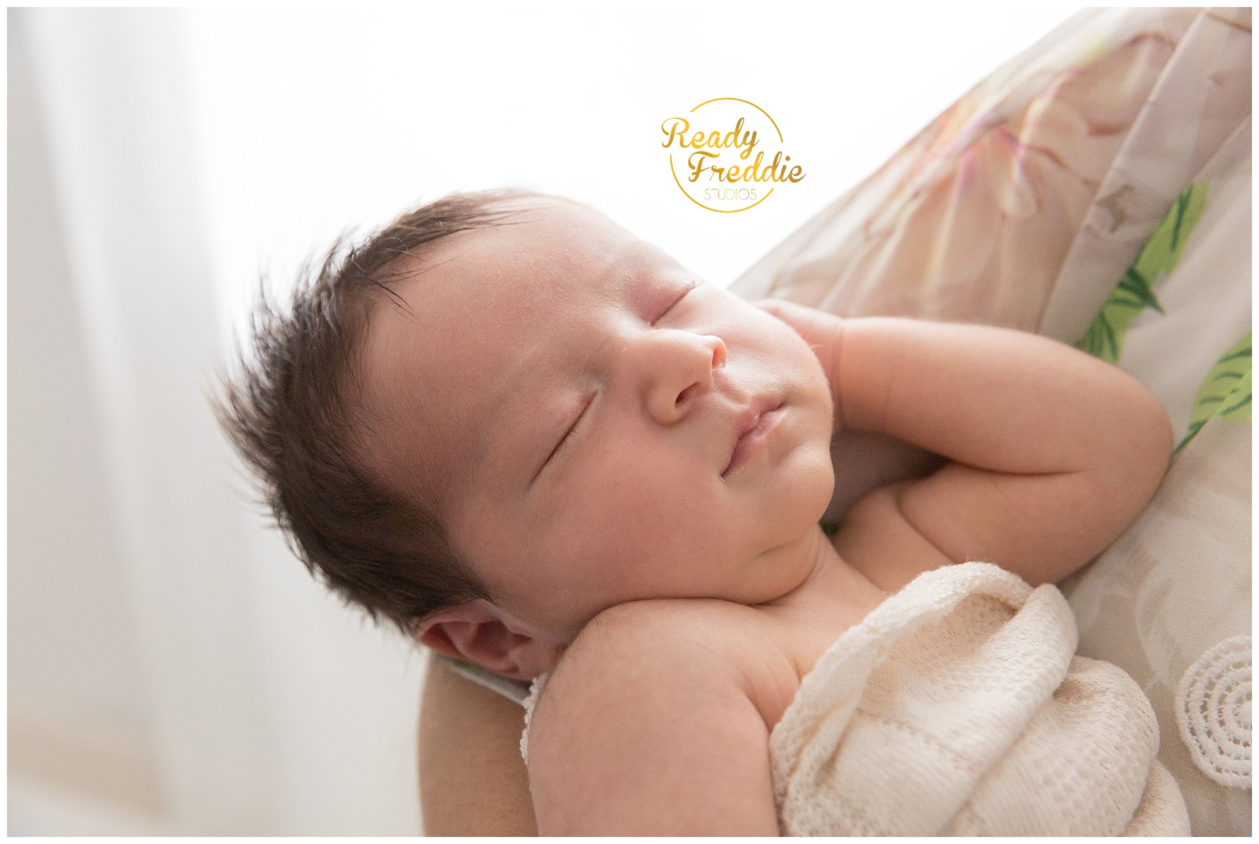 newborn baby sleeping during is photosession