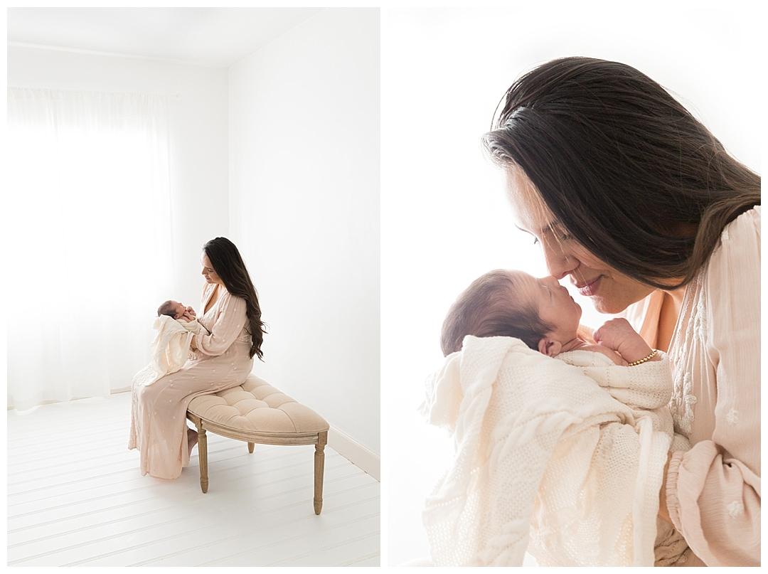 mom holding newborn baby | south fl newborn session