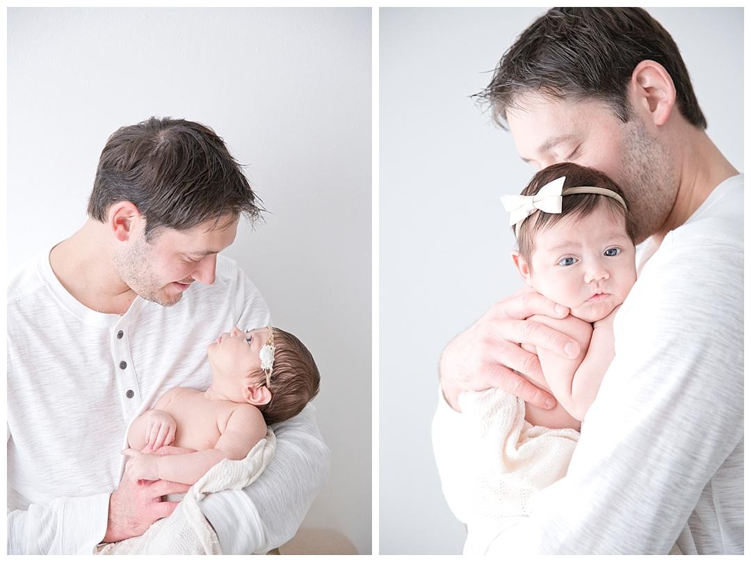 dad holding newborn baby girl | miami newborn photographers