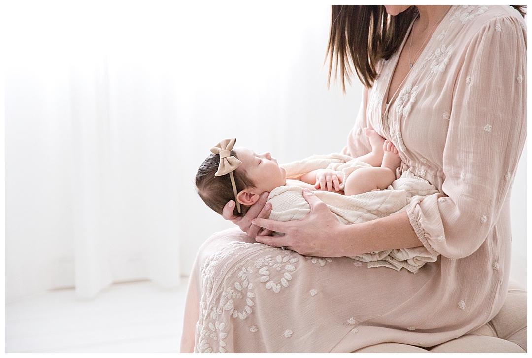 mom holding newborn baby | miami fl newborn photographer