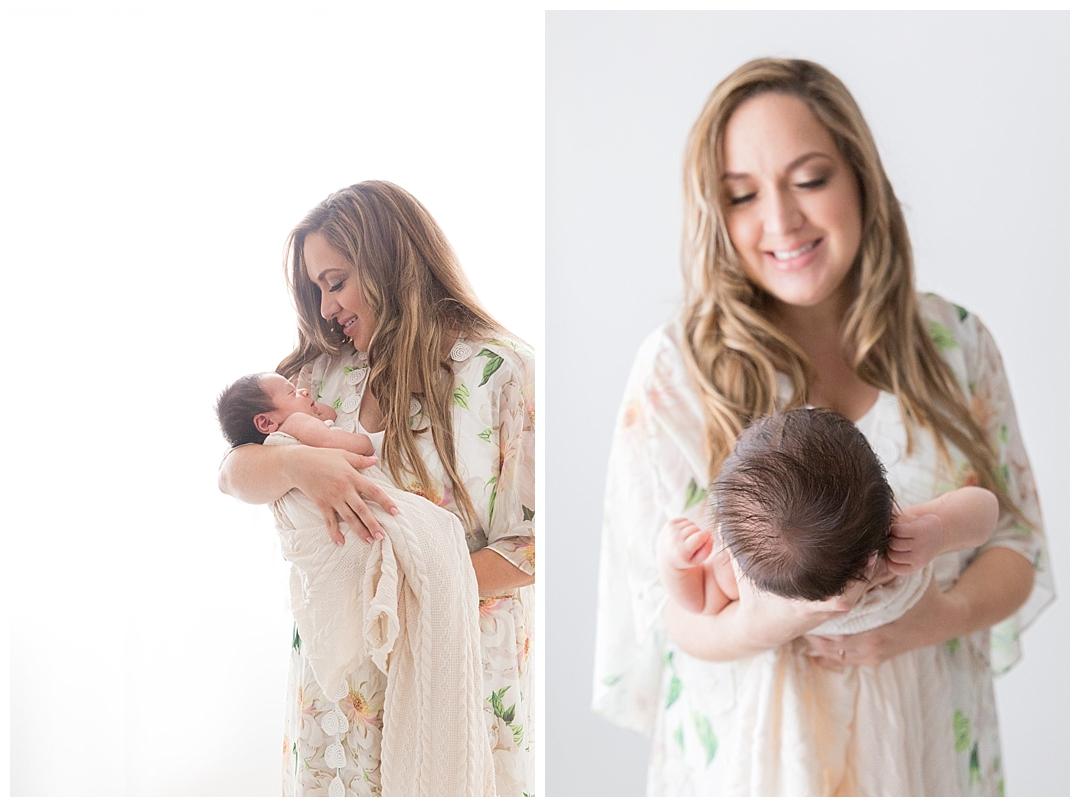 mom holding newborn during photoshoot | miami fl newborn photographer