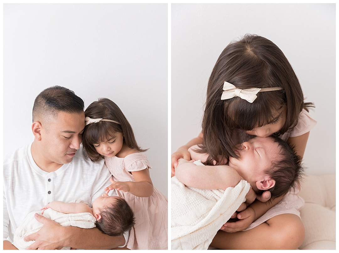 dad holding babies | miami family photography studios