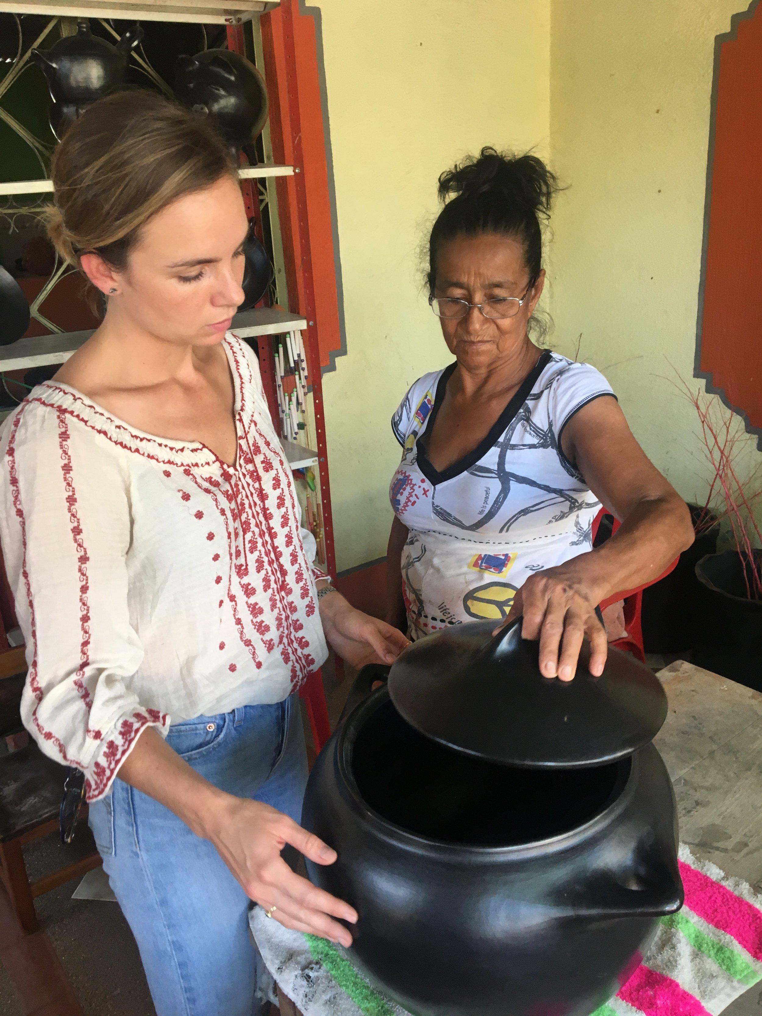 Malachi working with ceramicist Carmen.