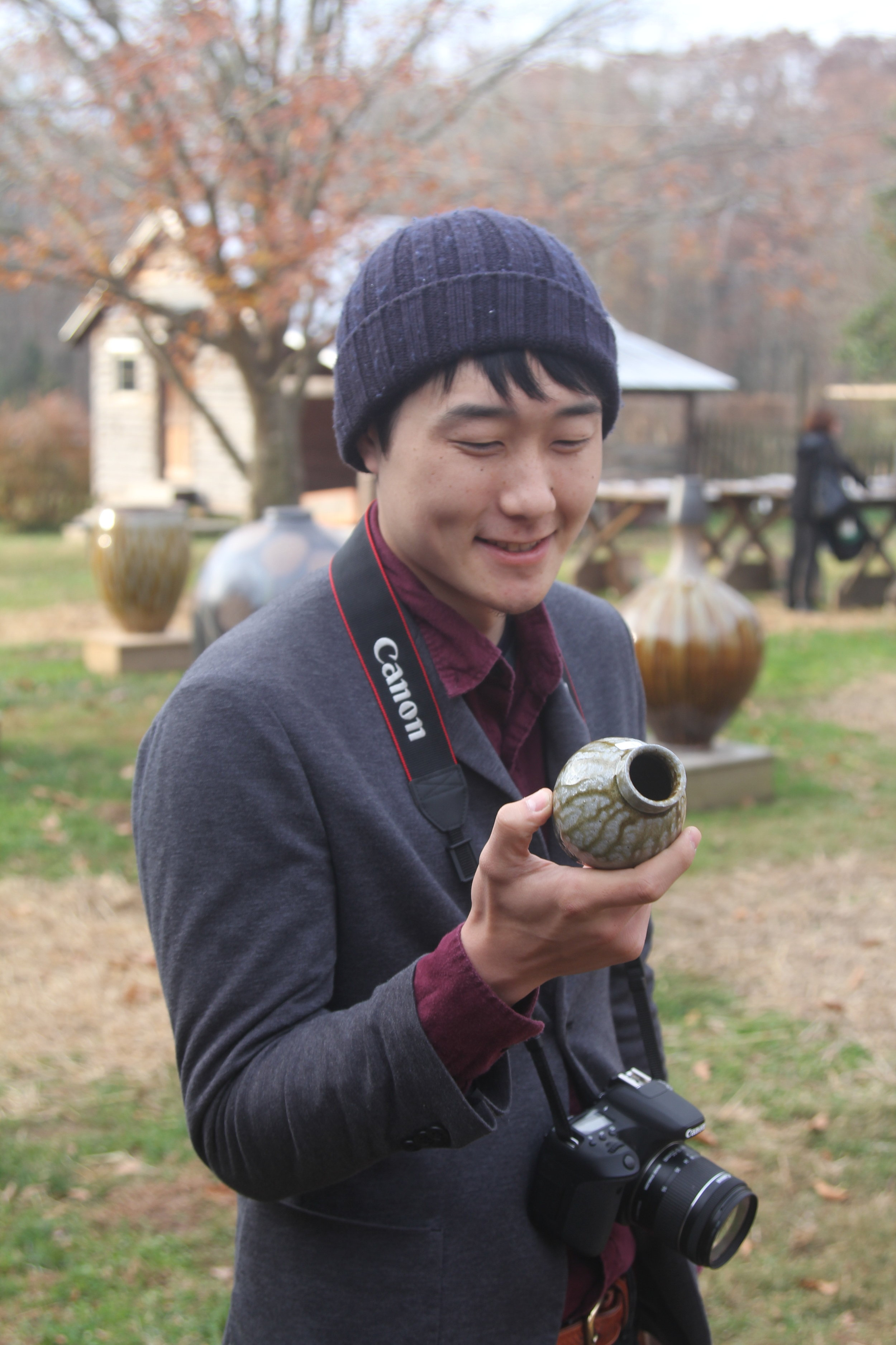 Yoshiya with one of his bud vases.
