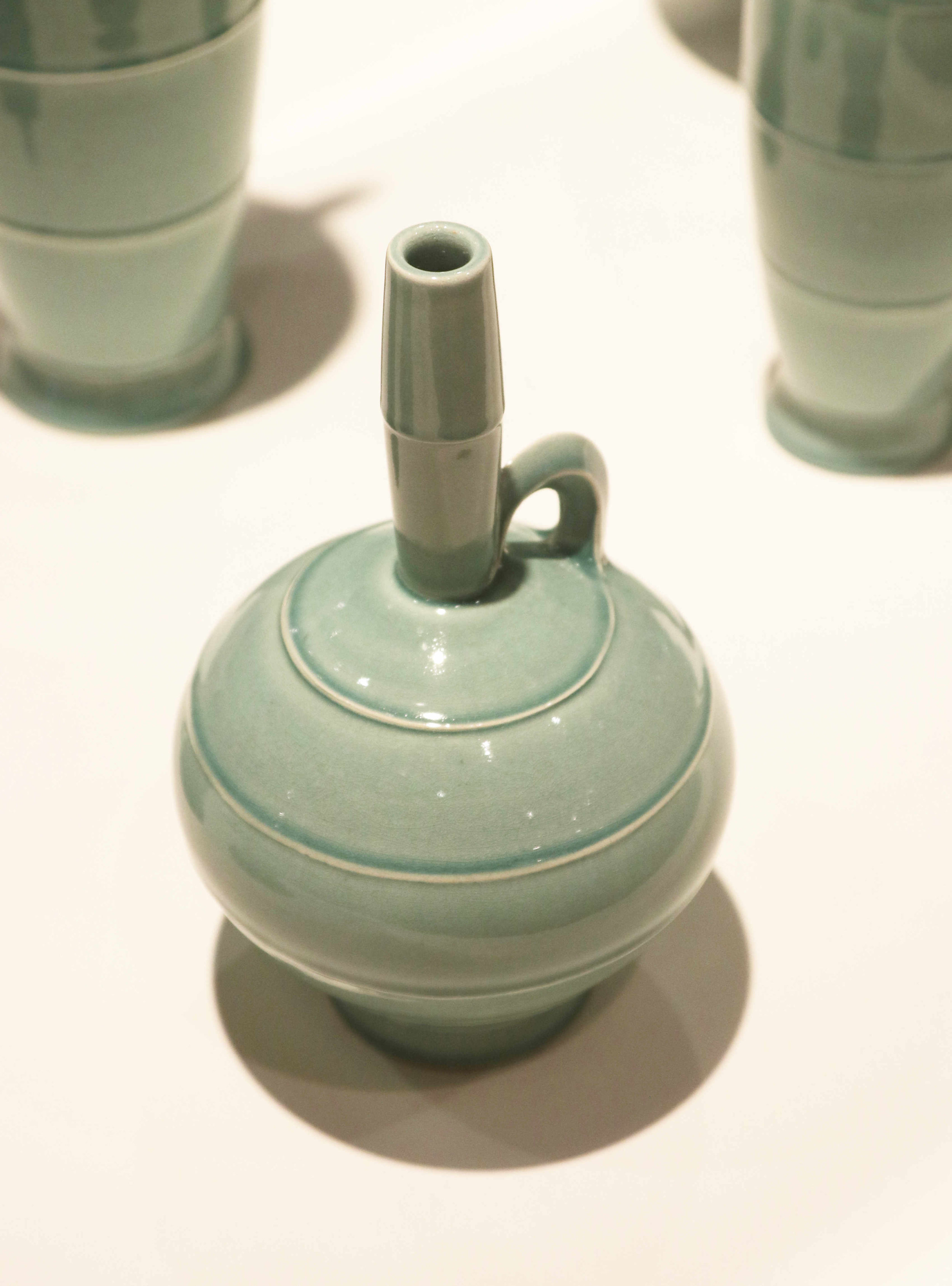Michael Sherrill, One of the Aqua Bottles, 1995. White Stoneware, celadon glaze.