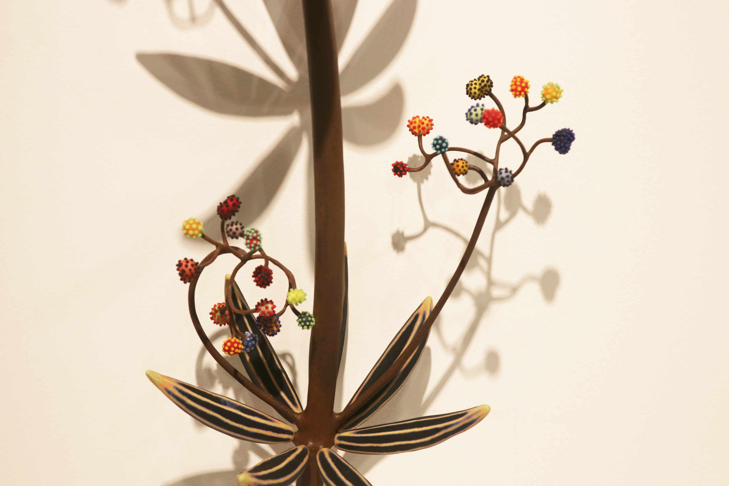 Michael Sherrill, How Plants Travel (detail), 2003. Porcelain, steel, glass.