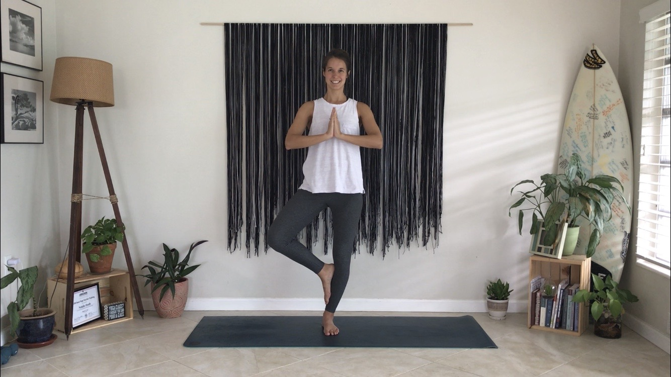 Example of tree pose with the elevated foot on the calf.