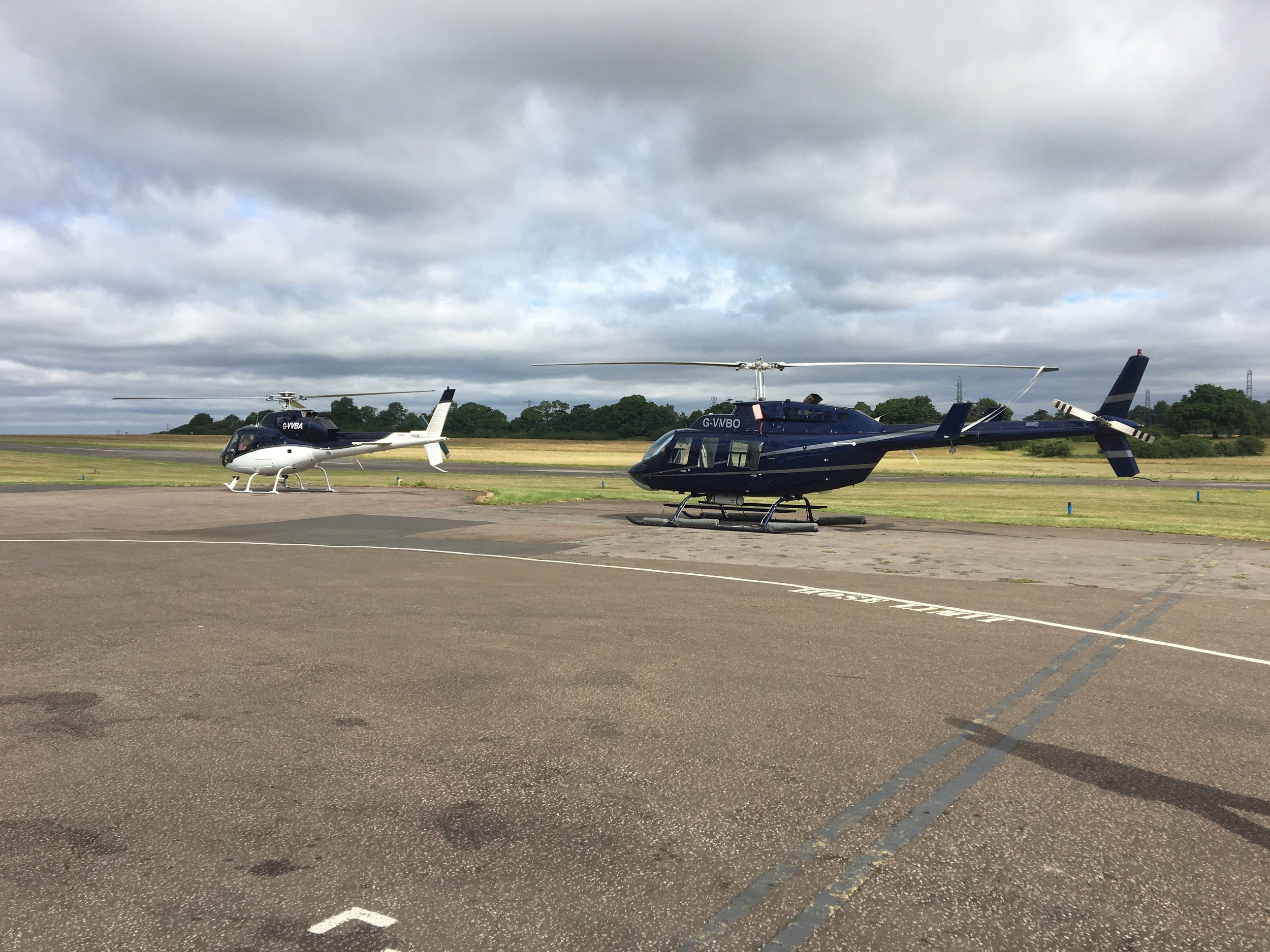 Helicopters parked on helipad at London Elstree Aerodrome Airport