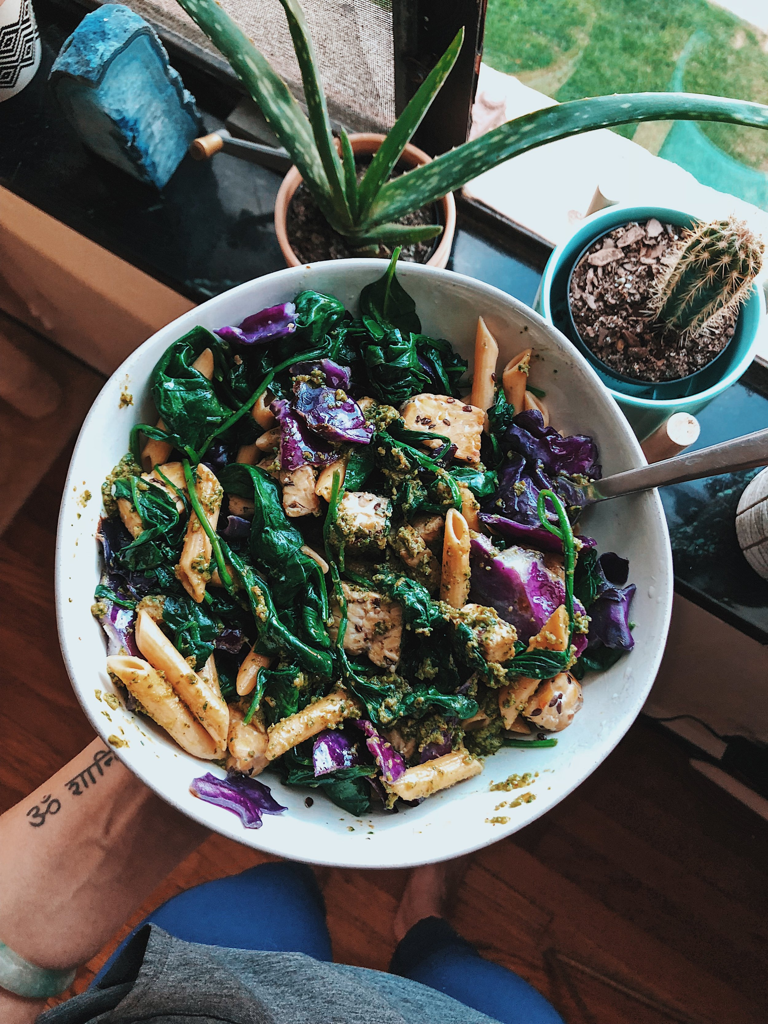Sautéed spinach, flax tempeh, and purple cabbage with Banza chickpea pasta and walnut pesto - yum!