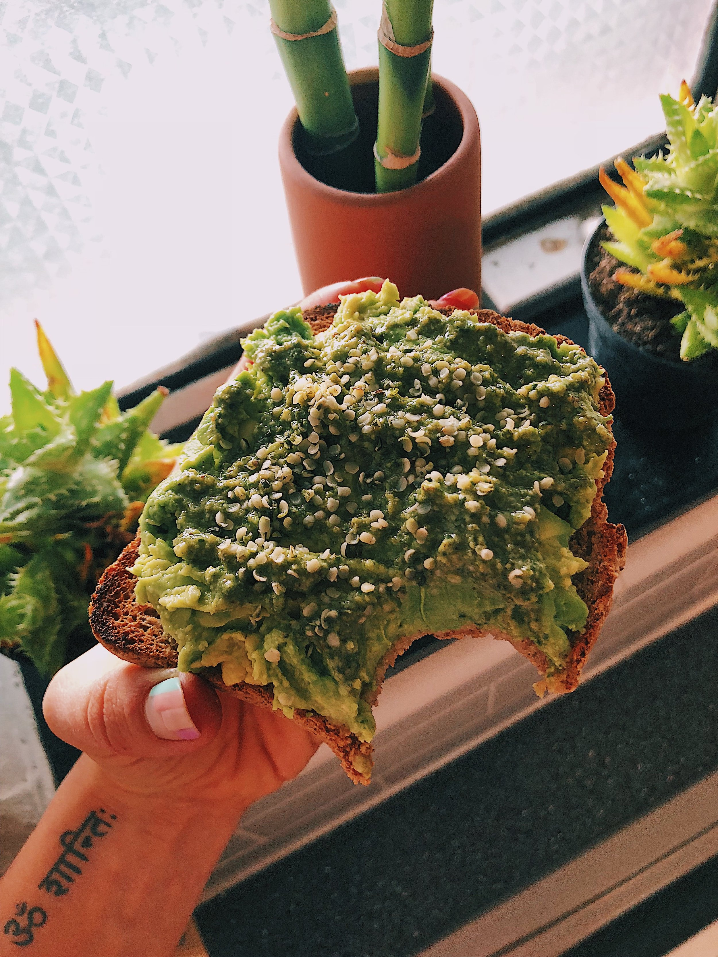 Toast with smashed avocado, walnut pesto, and hemp seeds