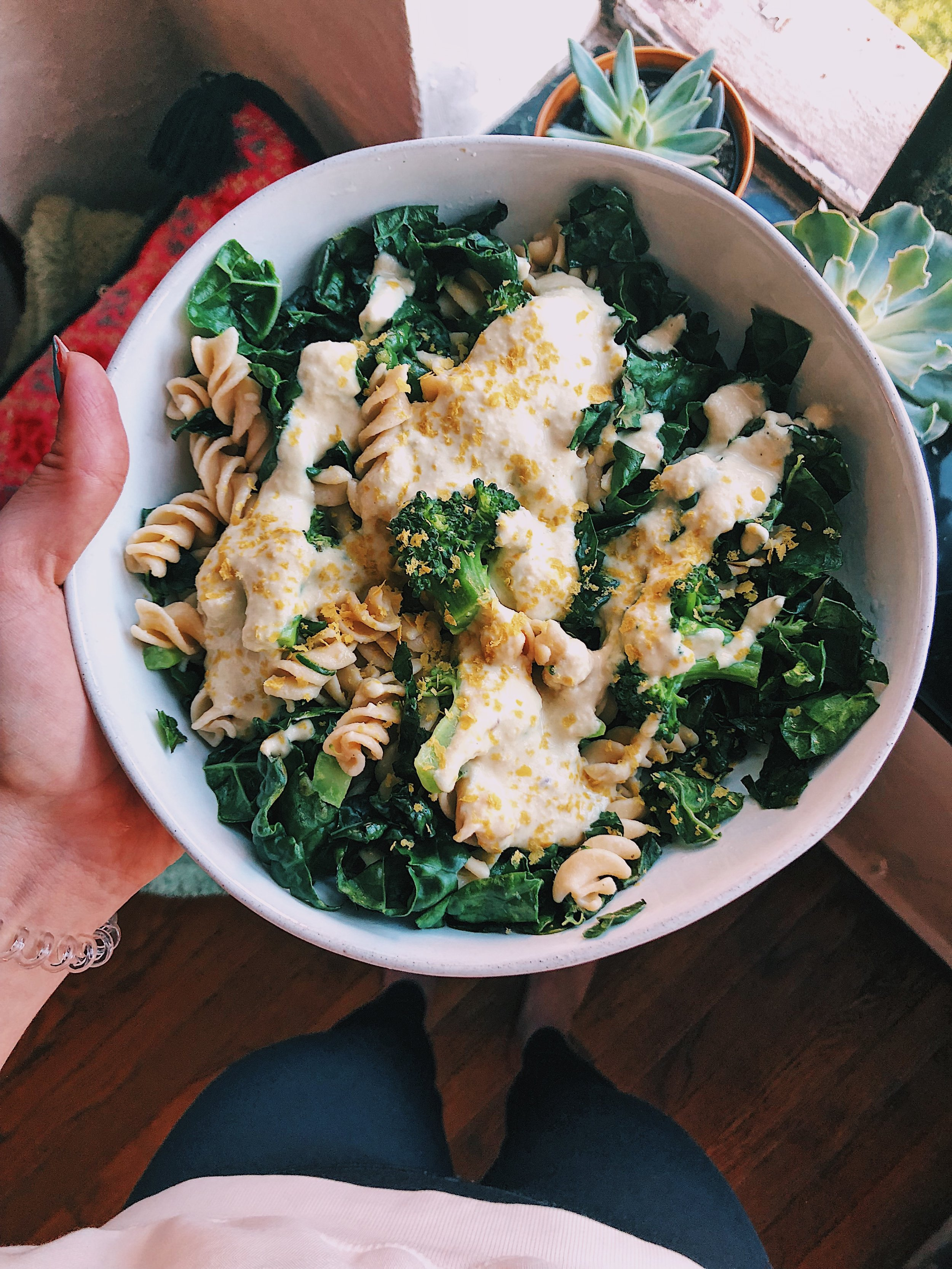 Sautéed kale and broccoli with Banza chickpea pasta,  cashew cream, and nutritional yeast.
