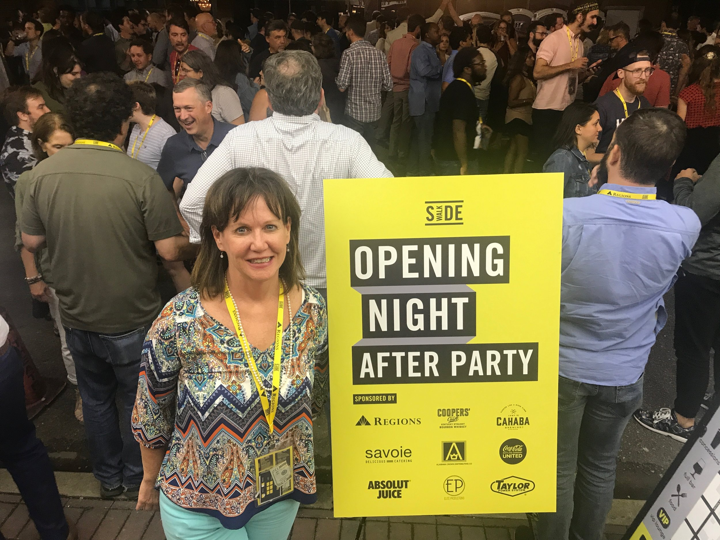 My mom, Kathleen, attending the Opening Night After Party that took up an entire block of downtown Birmingham.