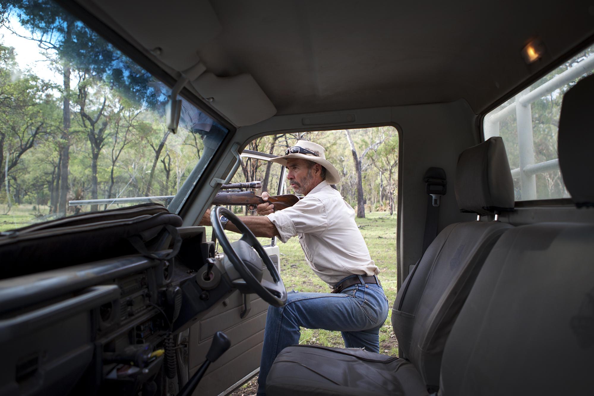 Farmer John Watkins aims to shoot a wild boar on his Queensland property Pindara.