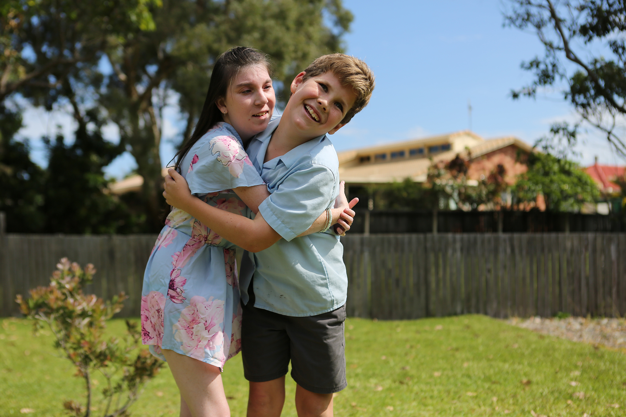 Tanisha has a rare genetic disorder which has resulted in intellectual and physical disabilities. Her younger brother Harley helps his mother take care of her.  Featured in The Guardian Australia
