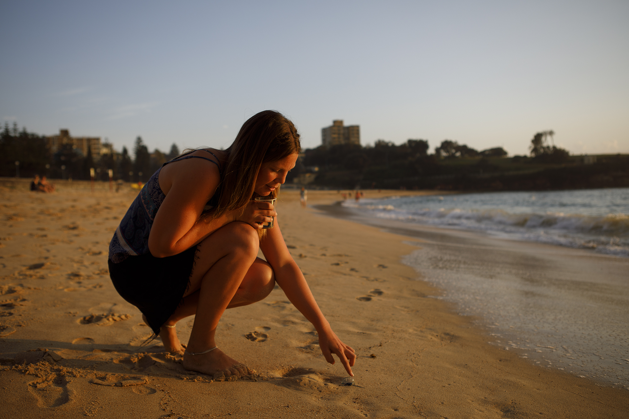University of NSW Physical Oceanographer Dr Amandine Schaeffer at Coogee Beach looking at some bluebottle jellyfish samples as part of a research project.