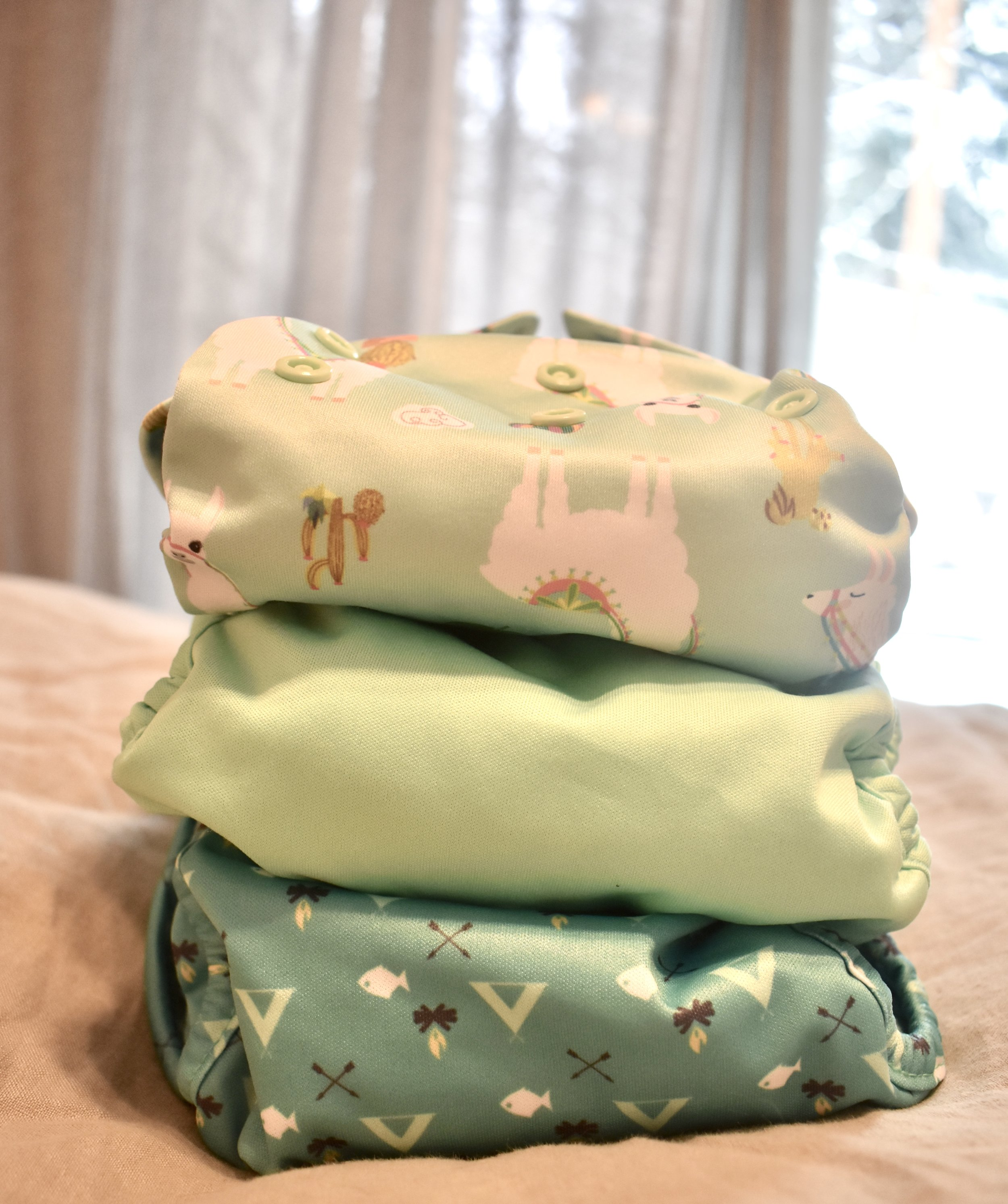 Covers, stuffed and ready to go (top to bottom:  luludew ,  rumparooz , and  petite crown )