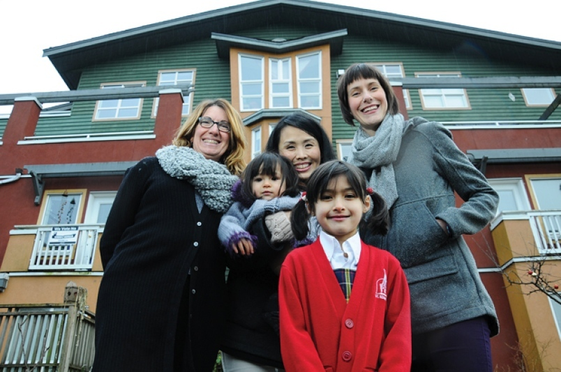 Marta Carlucci and Natsuko Osafune, Osafune's daughters Mia and Aina, and Mackenzie Stonehocker are a few of the Driftwood Village Cohousing Community that are bringing co-housing to Chesterfield Avenue, North Vancouver. Photo Cindy Goodman, North Shore News