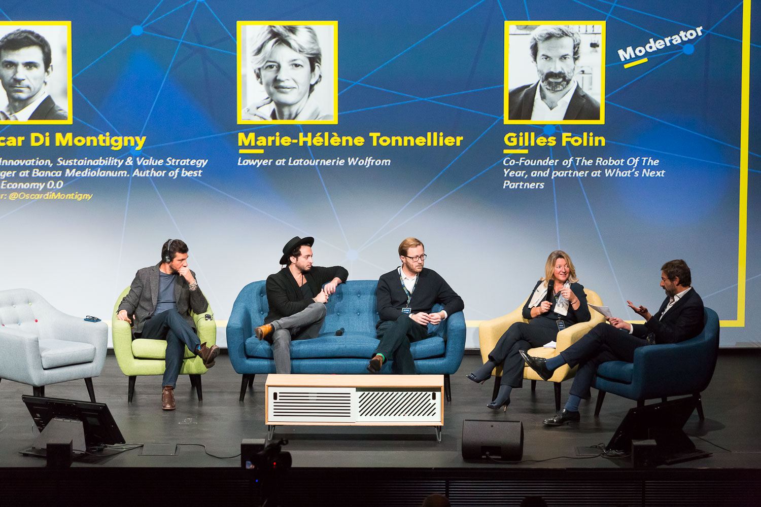 PANEL FOUNDING A BETTER FUTURE FOR HUMANS WITH AI AND ROBOTS  Speakers : Oscar  Di Montigny  – Chief Innovation, Sustainability & Value Strategy Manager at Banca Mediolanum . Author of best seller Economy 0.0, Rand  Hindi  - Data scientist and CEO of Snips, Pierre  Lebeau  - Founder at Keecker, Marie-Hélène  Tonnellier  - Lawyer at Latournerie WolfromP - Moderator : Gilles  Folin  – Co-Founder of The Robot Of The Year, and partner at What's Next Partners. Photo Svend Andersen