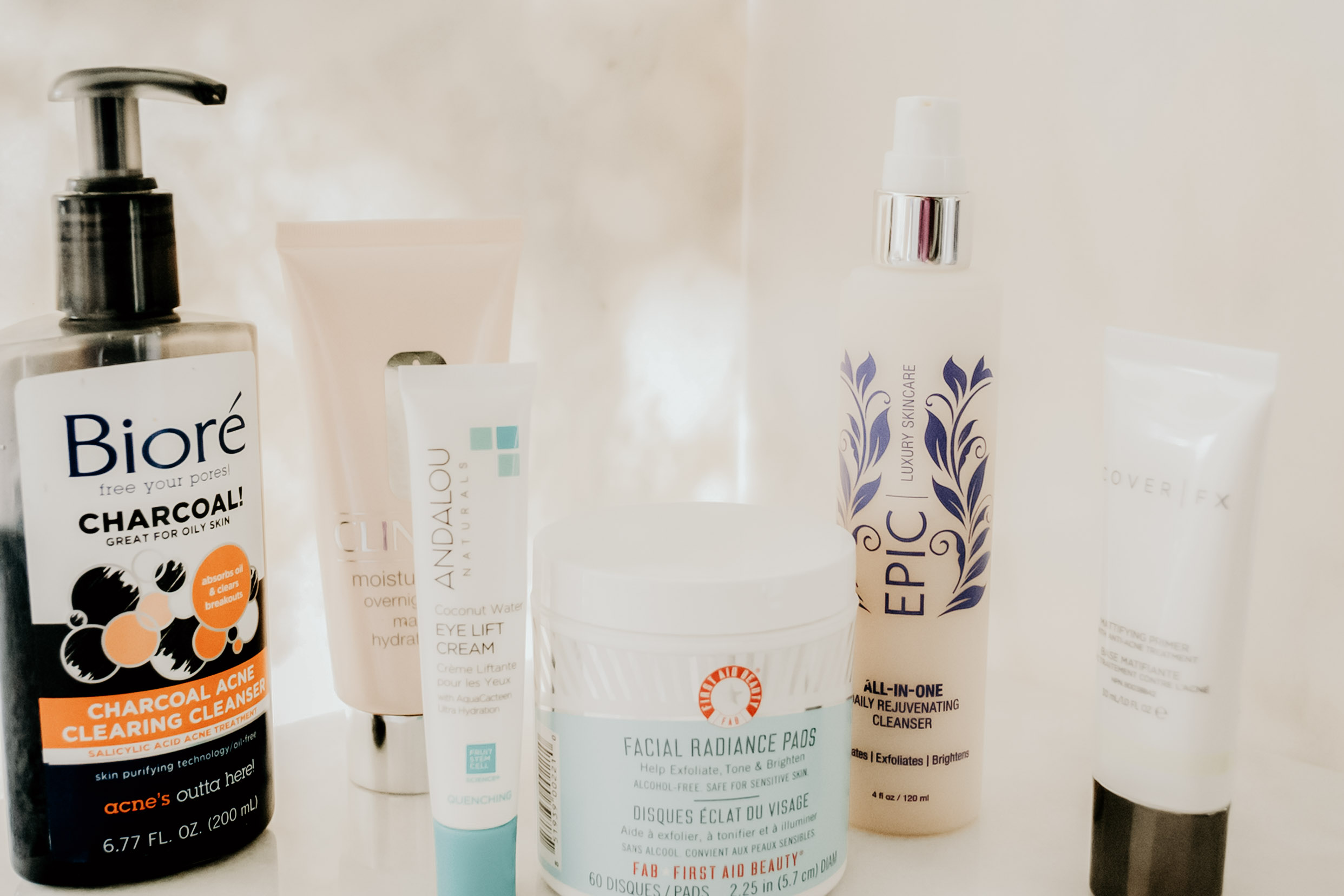 Left to Right ( Biore Charcoal Acne Clearing Cleanser/  Clinique Moisture Overnight Mask /  Andalou Eye Life Cream Coconut Water /  First Aid Facial Radiance Pads /  Epic Luxury Skincare All-In-One Daily Rejuvenating Cleanser /  Cover FX Mattifying Primer )