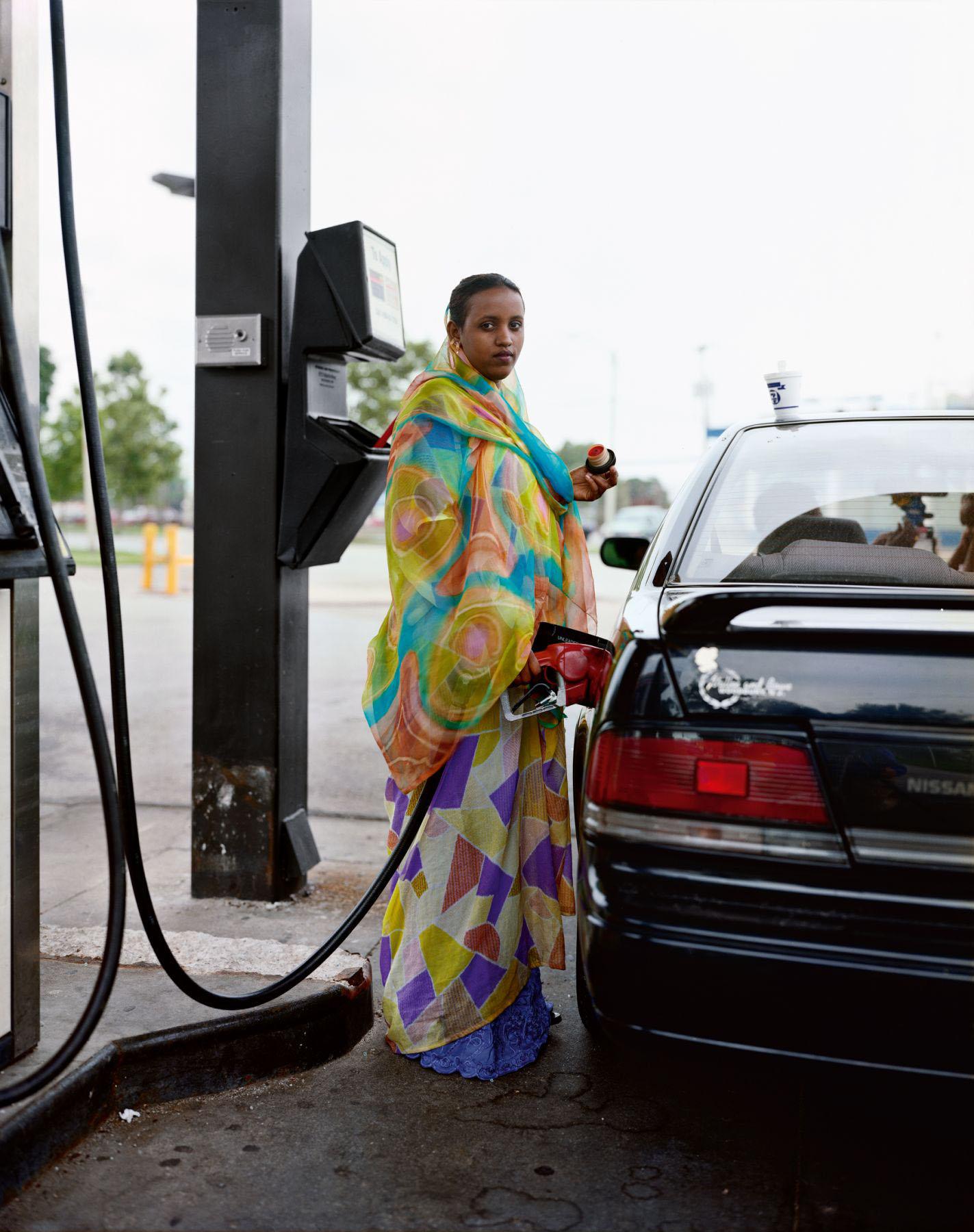 A Woman Pumping Gasoline, Kasas City, Kansas, June 1999