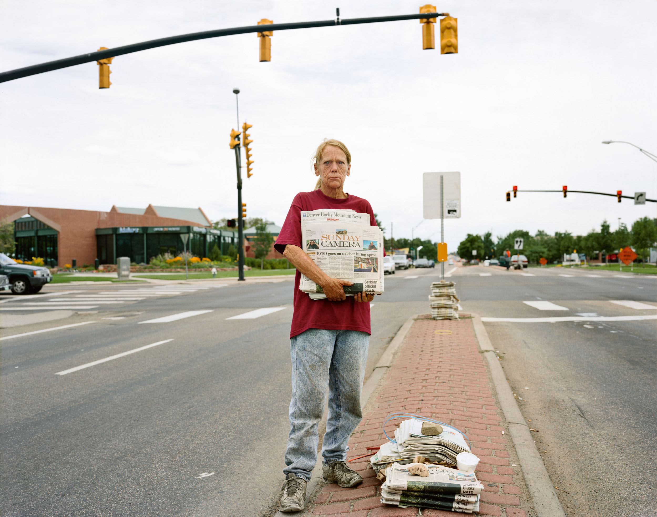 A Woman Selling the Sunday Papers, Boulder, Colorado, July 1999
