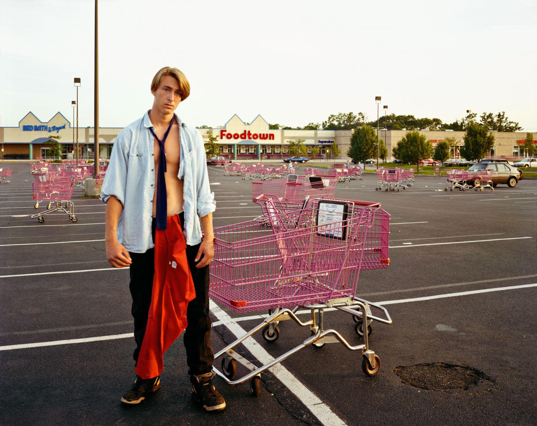 A Young Man Gathering Shopping Carts, Huntington, NY, July 1992