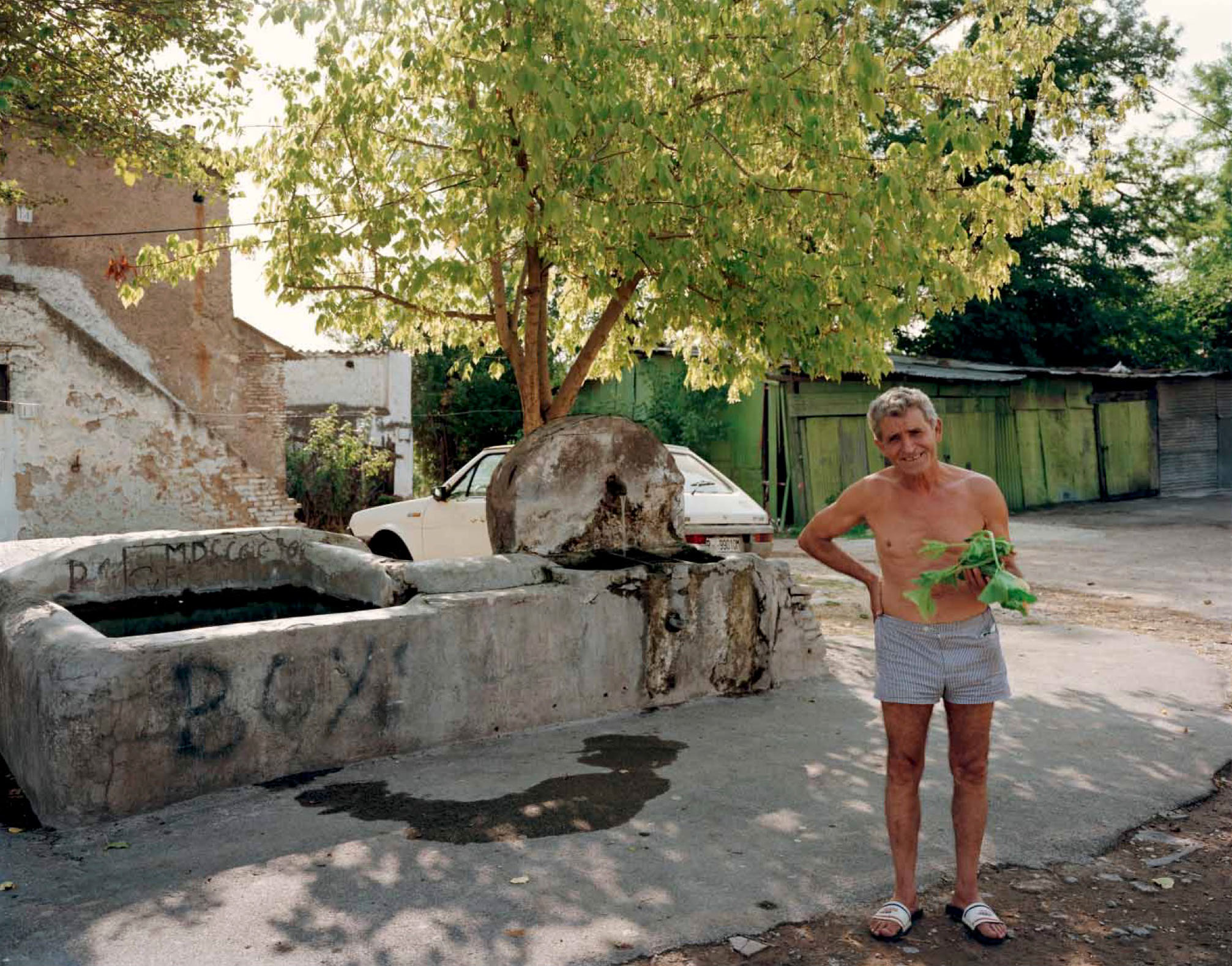 A man who has just washed kohlrabi in a fountain, Roma Vecchia, August 1990
