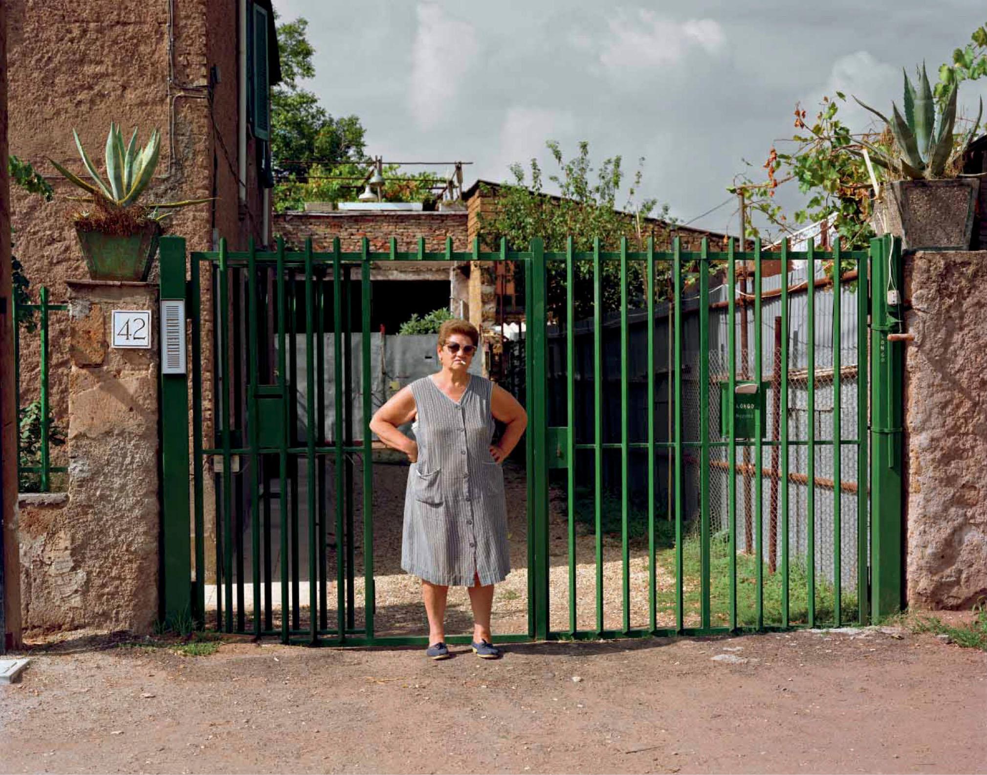 A woman outside her home, Via Appia Nuova, August 1990