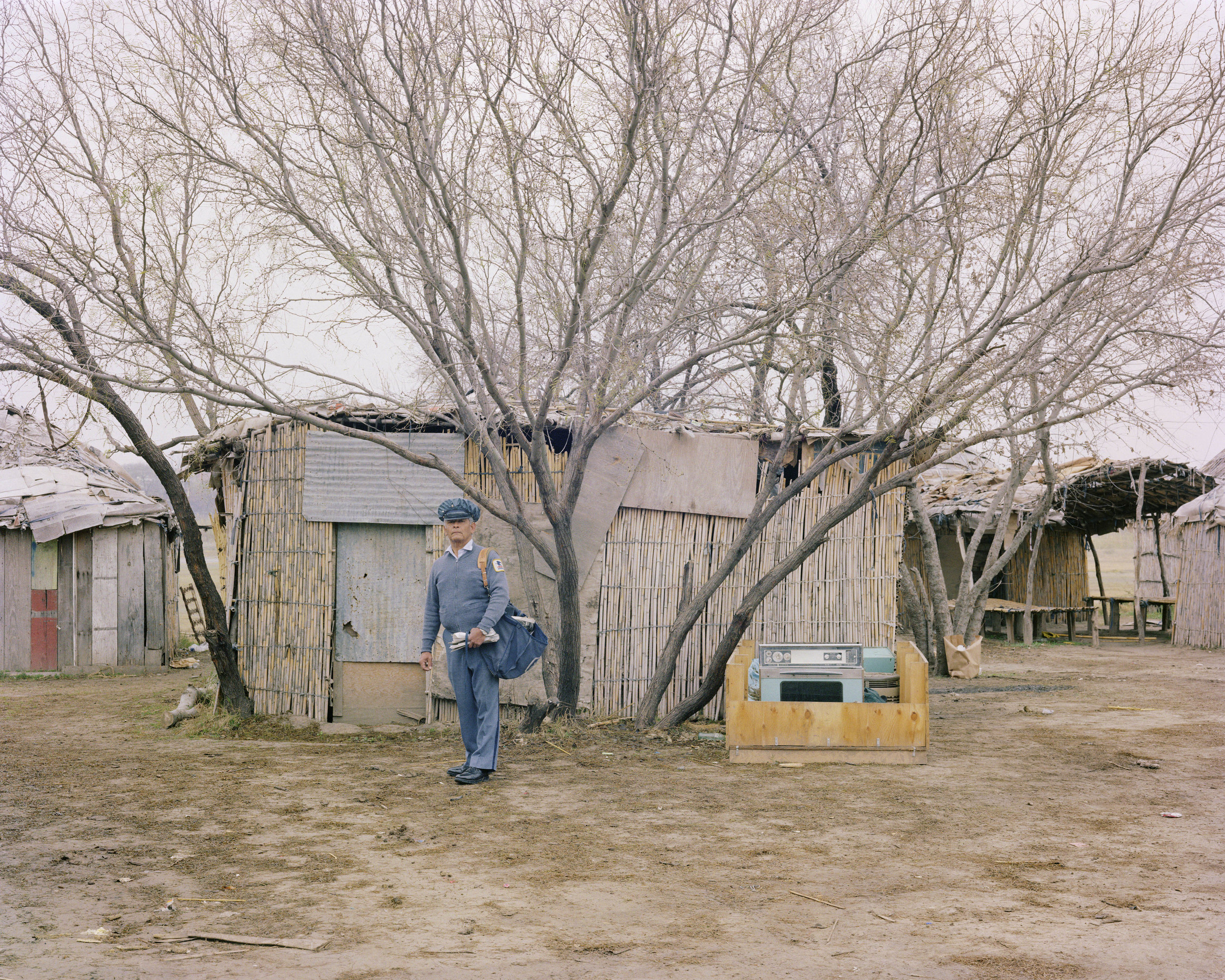 A Letter Carrier Delivering Mail in a Kickapoo Tribe Village, Eagle Pass, Texas, January 1983