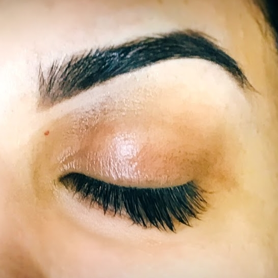 Waxed, arched, natural looking brows