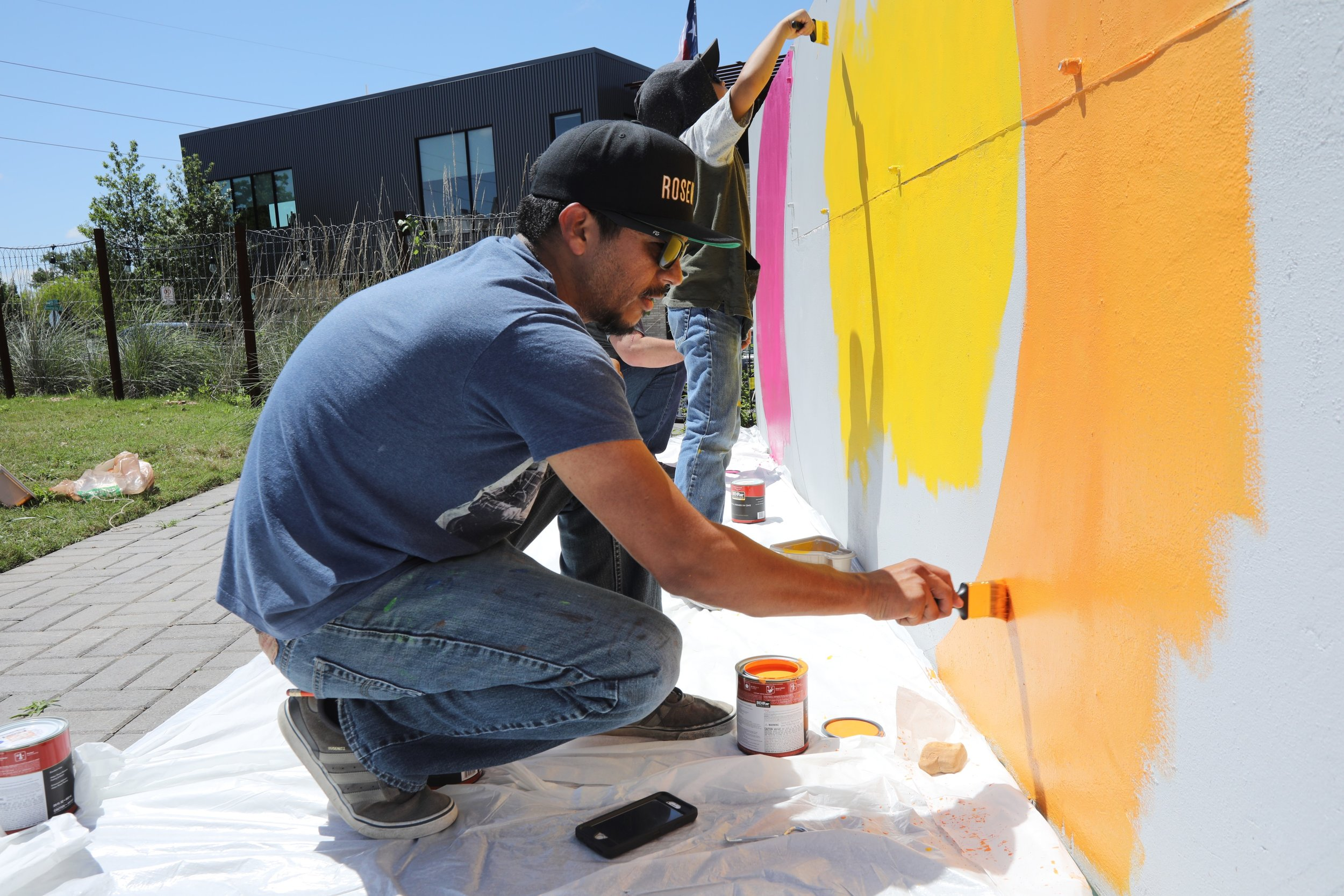 Ernesto begins painting of Rosewood Restaurant Mural.