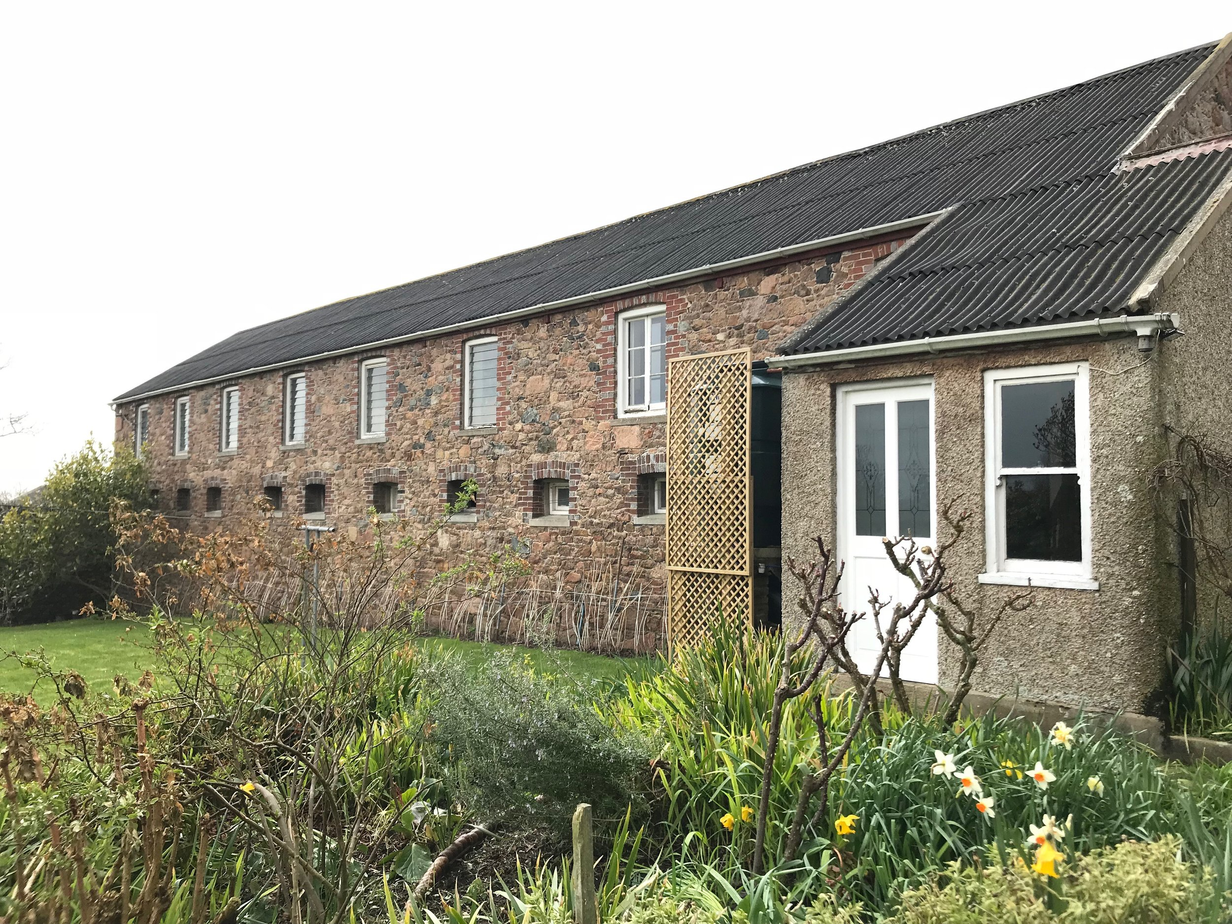 The yoga studio is set within a walled garden above the stables.