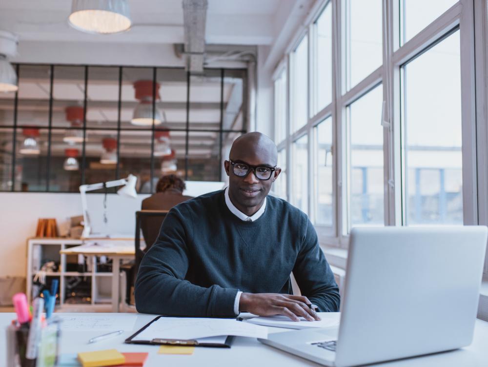 Canva - African Businessman Working in Modern Office-2.jpg