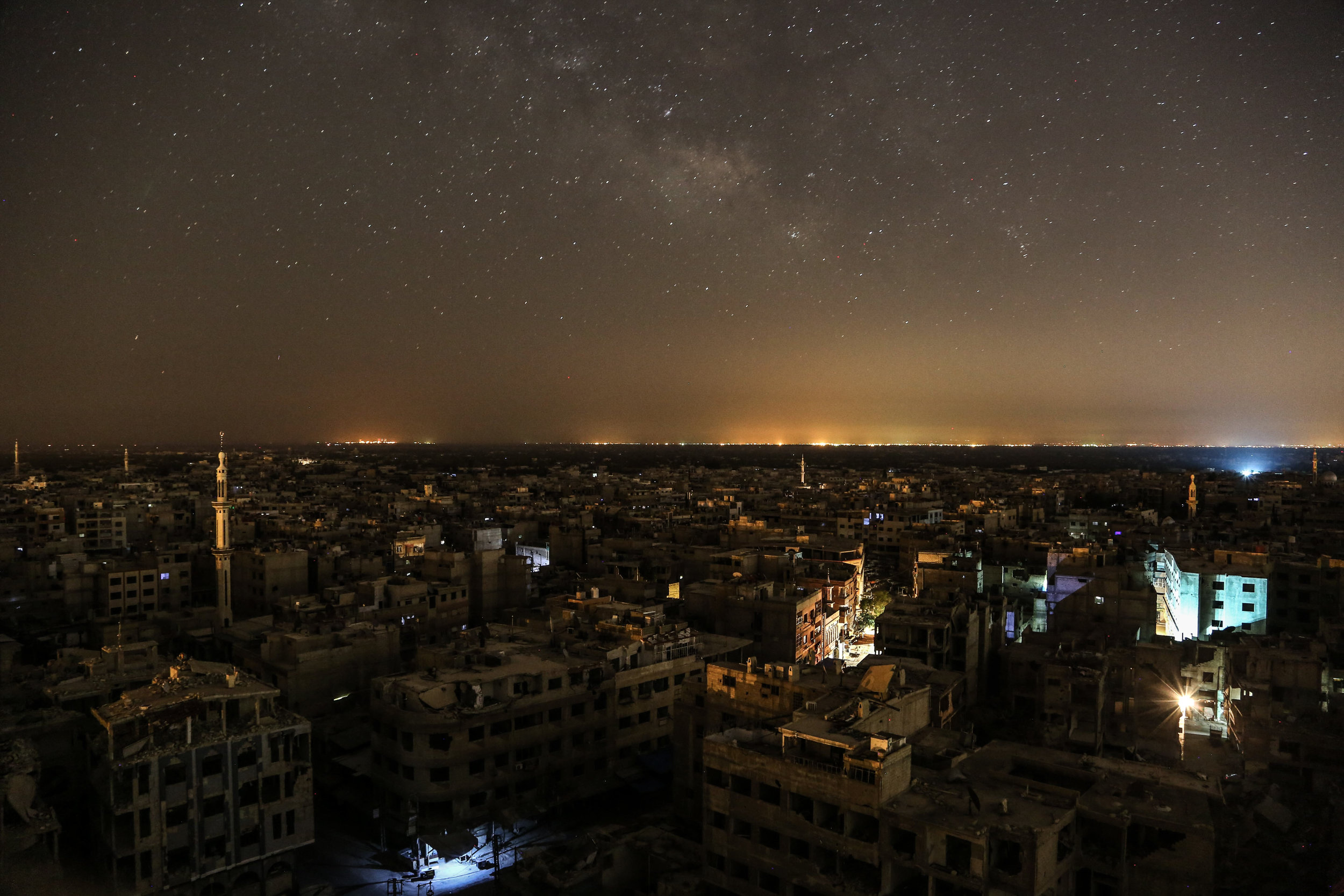 A general view shows the damaged buildings at night in the city of Douma, as the Syrian government deprived people there from the electricity for more than 5 years.