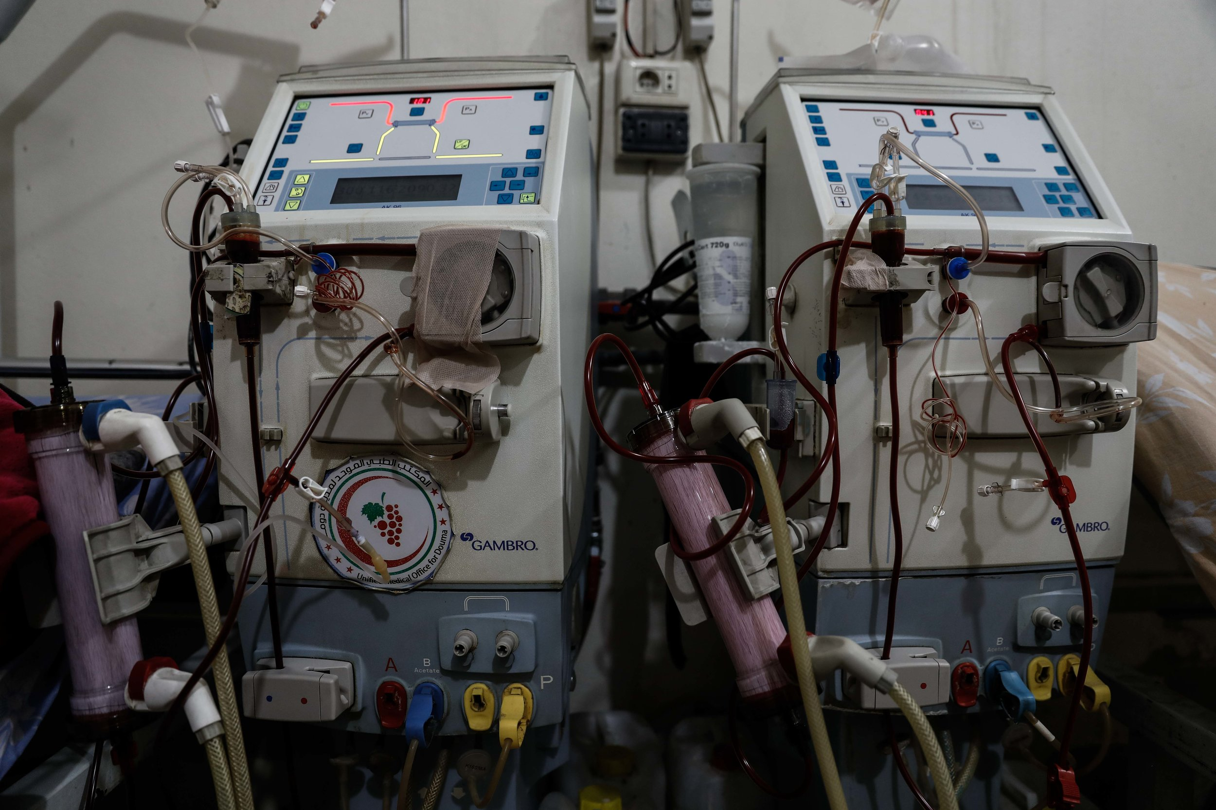 - A picture shows a damaged dialysis machine inside a basement-turned-clinic in the city of Douma.