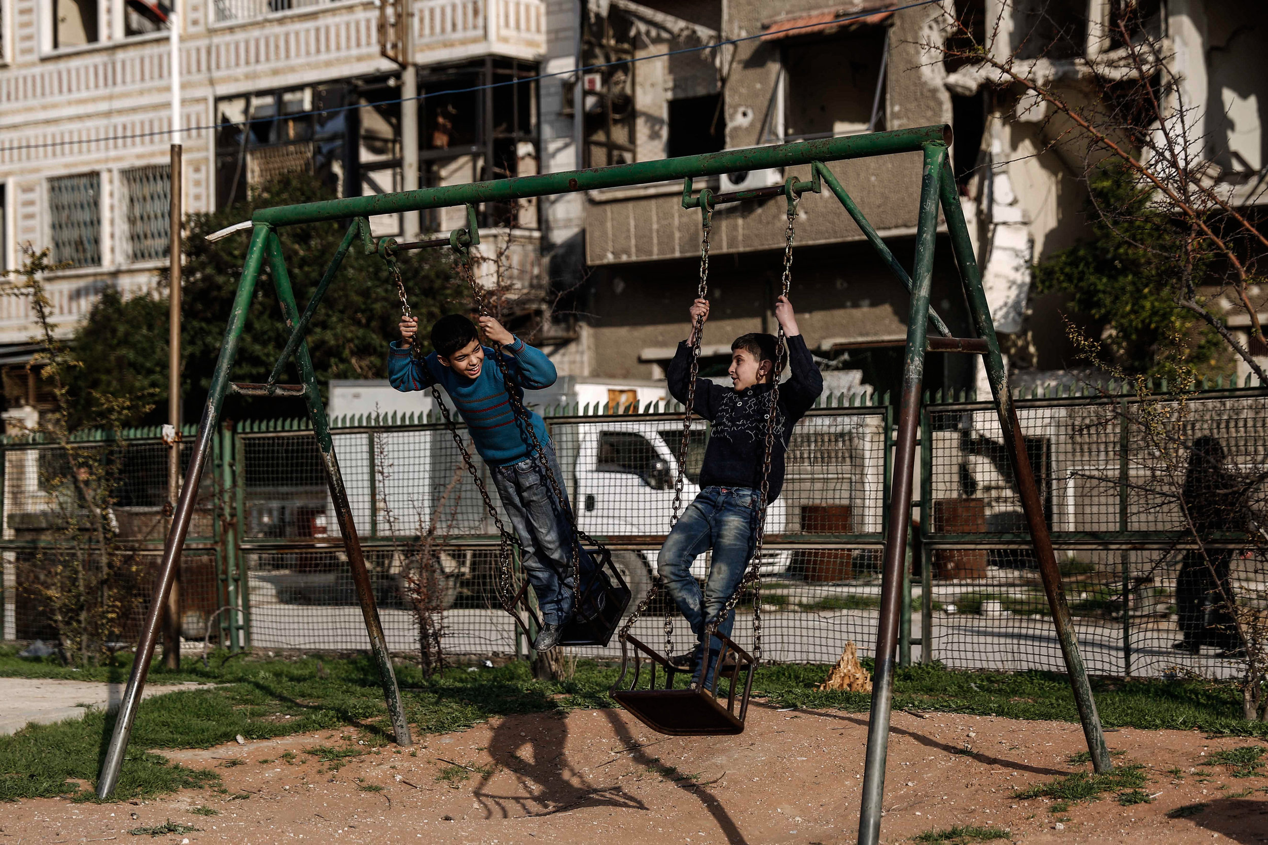 - Children play on a swing at a park in the city of Douma, on the eastern edges of the capital Damascus on February 27, 2016, on the first day of the landmark ceasefire agreement.