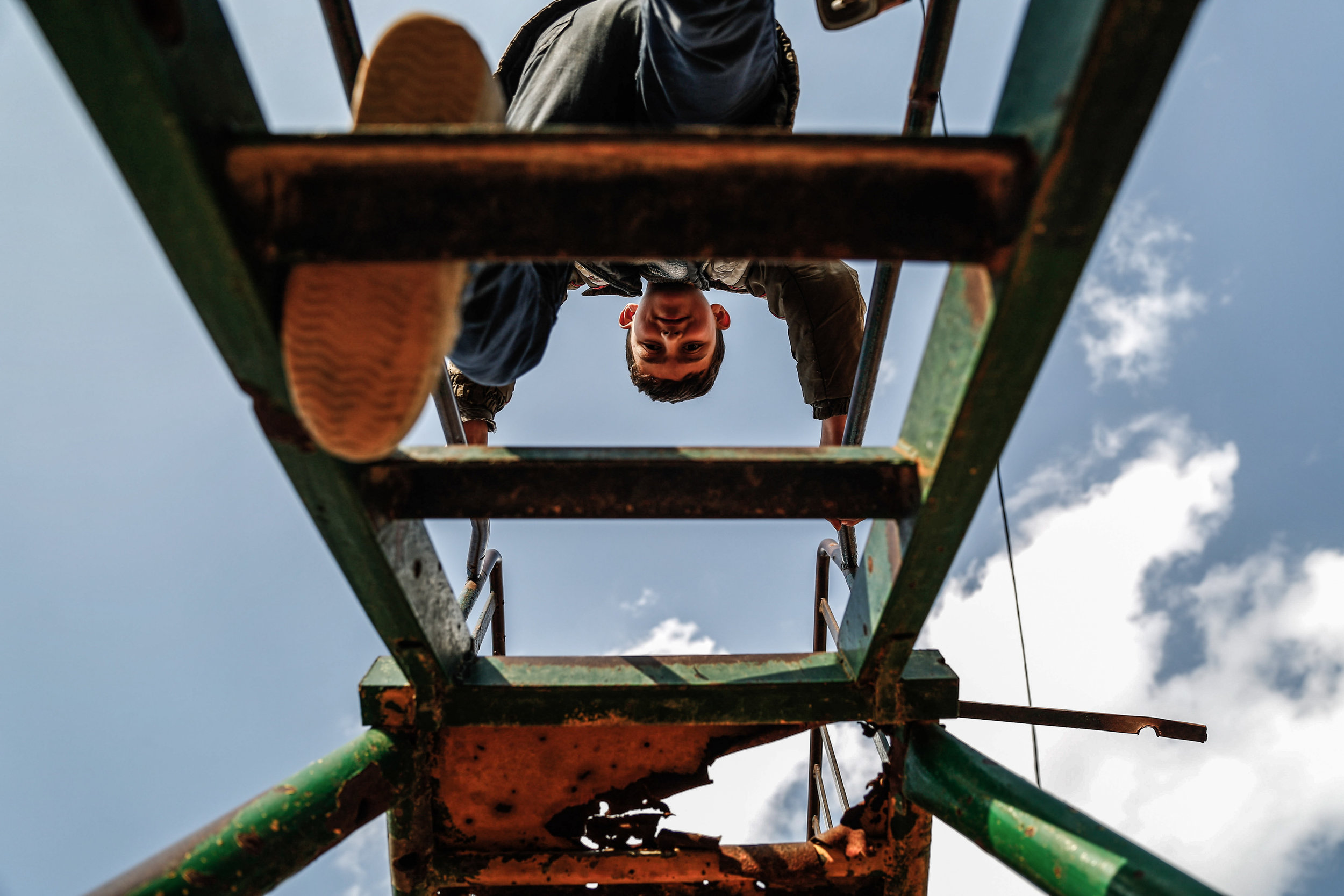 - A boy climbs a slide at a park in the city of Douma, on the eastern edges of the capital Damascus on February 27, 2016, on the first day of the landmark ceasefire agreement.