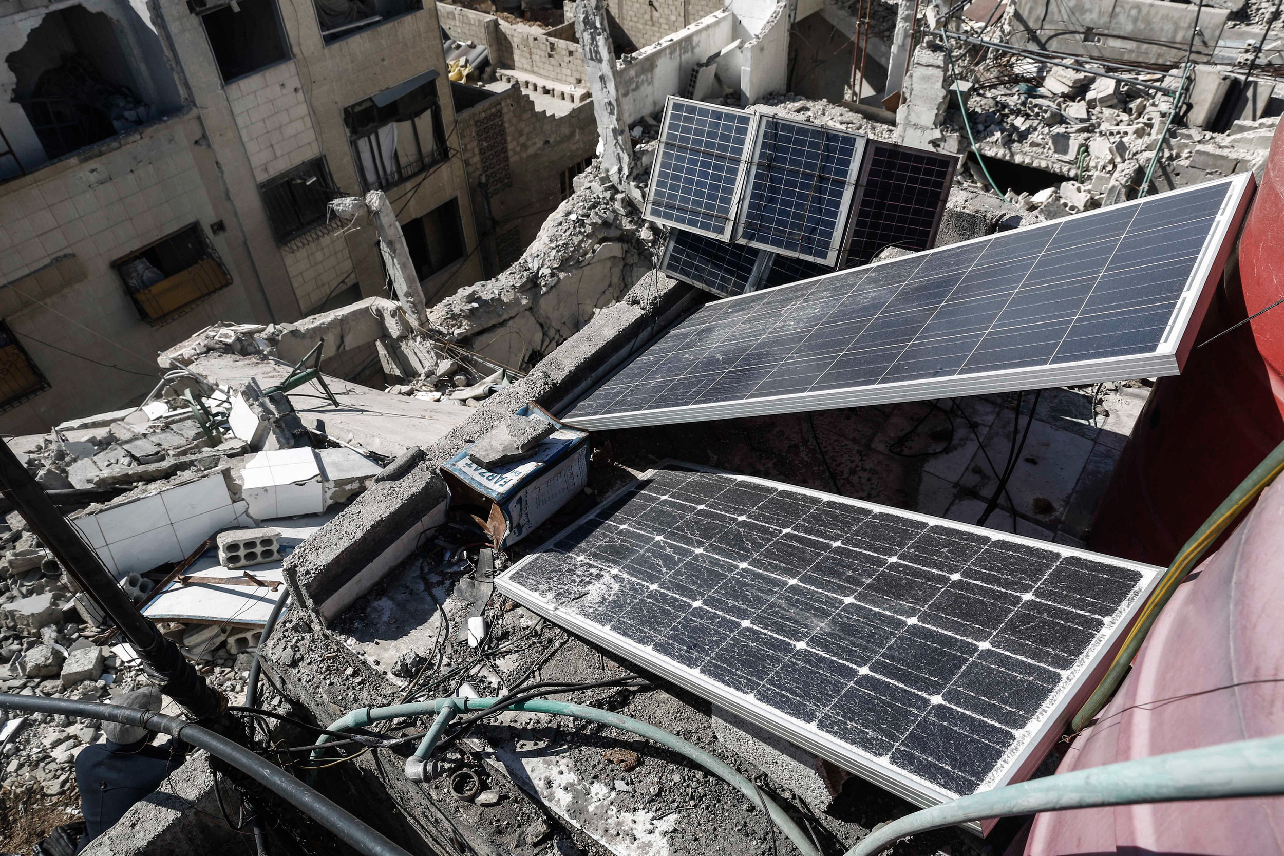 - The solar chargers are seen on the top of a destroyed building in the city of Douma.