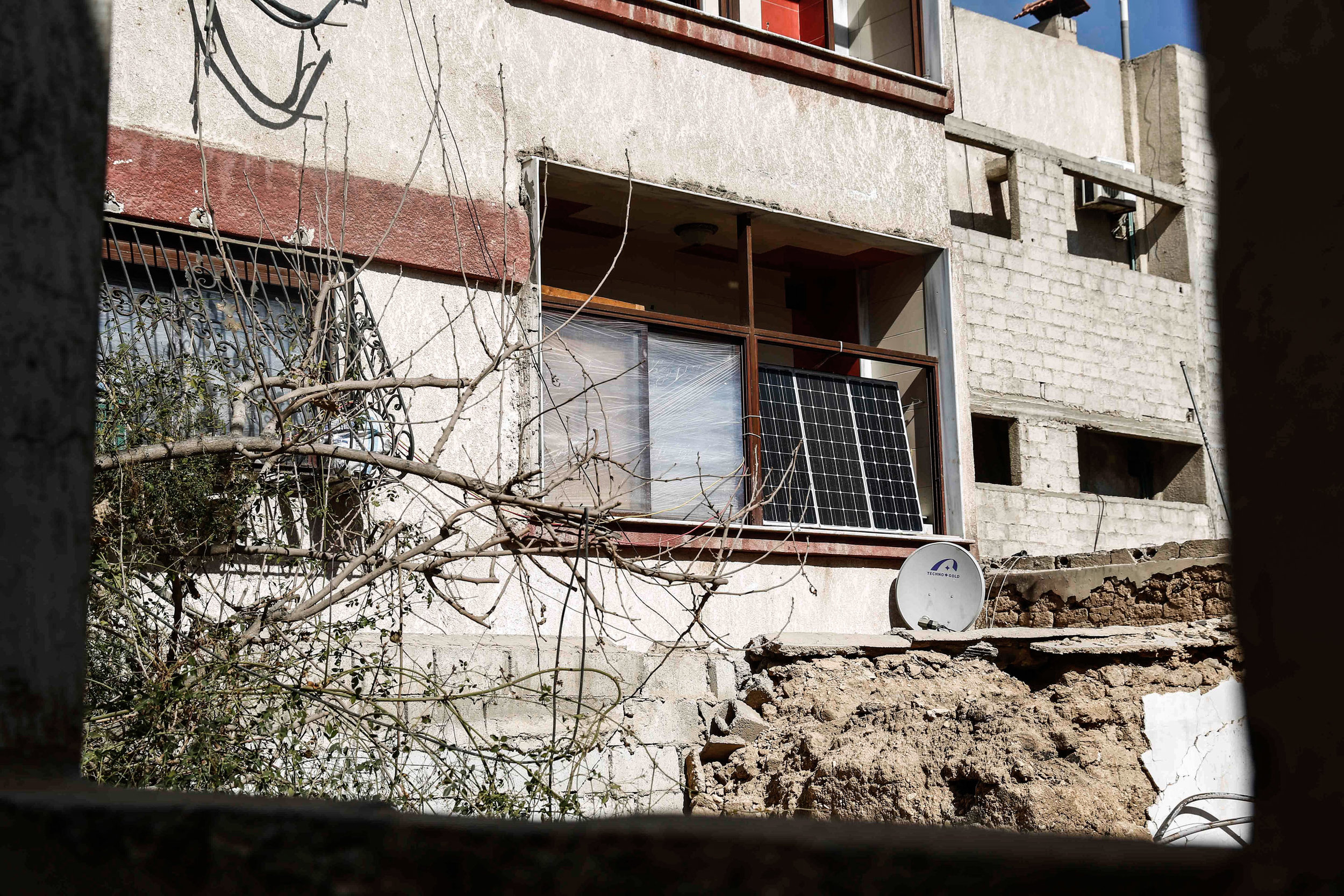 - People put solar chargers instead of the damaged window in the Syrian city of Douma.