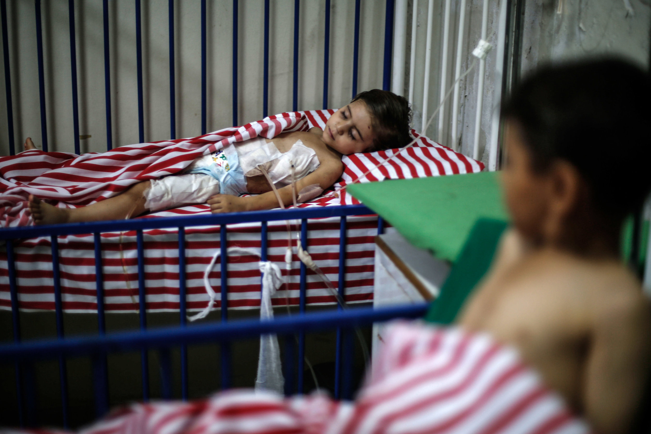 - Maya, a 4-year-old Syrian girl, lies in an underground hospital bed after she was injured the day before following air strikes by Syrian government forces on a marketplace in the city of Douma, on August 17, 2015.