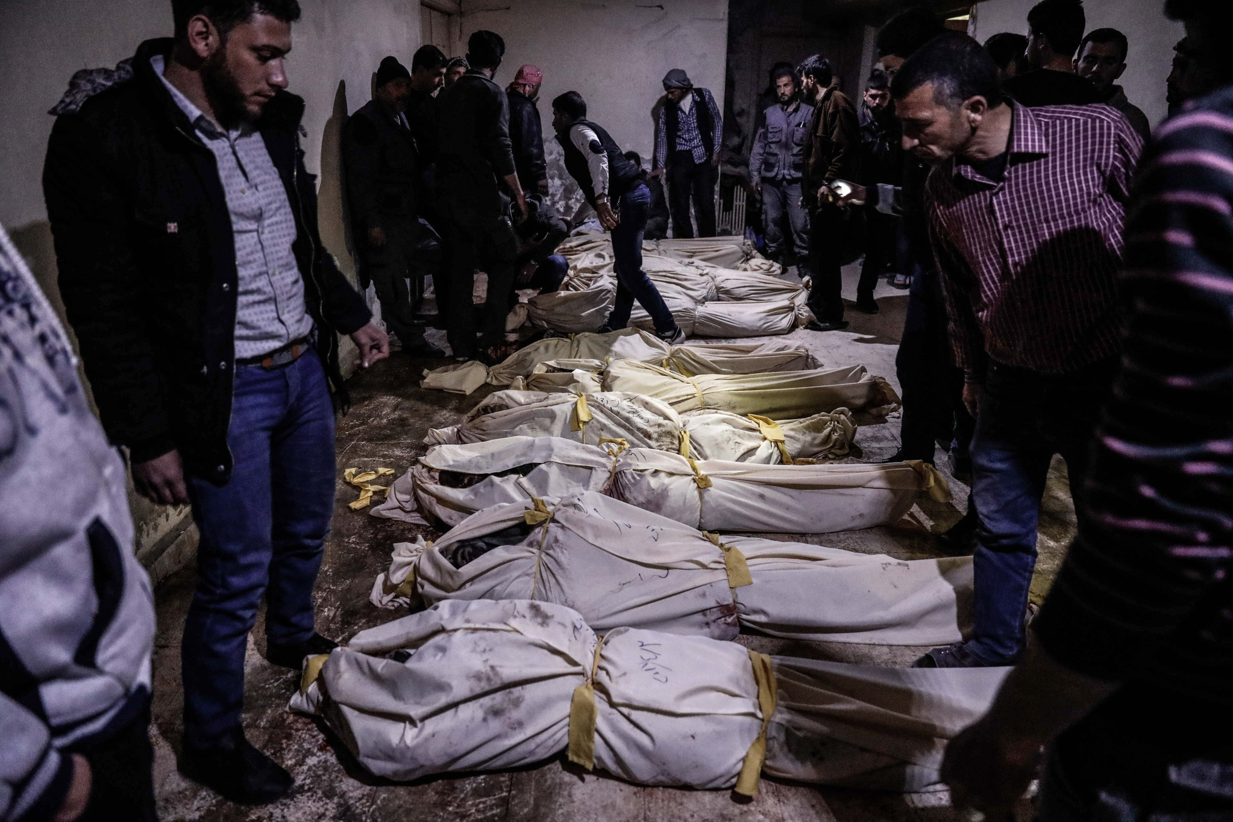 - A picture shows the bodies of people who were killed during the shelling lying down in an underground morgue.