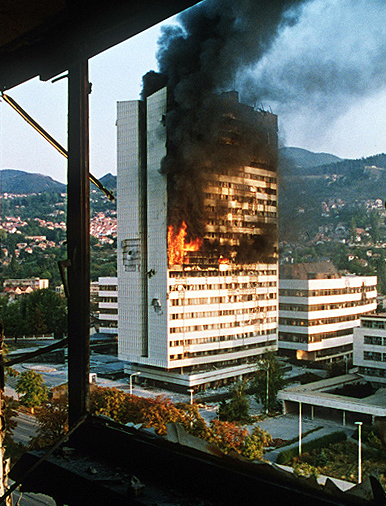 Sarajevo's government building burns during the siege. Photo by    Mikhail Evstafiev   .