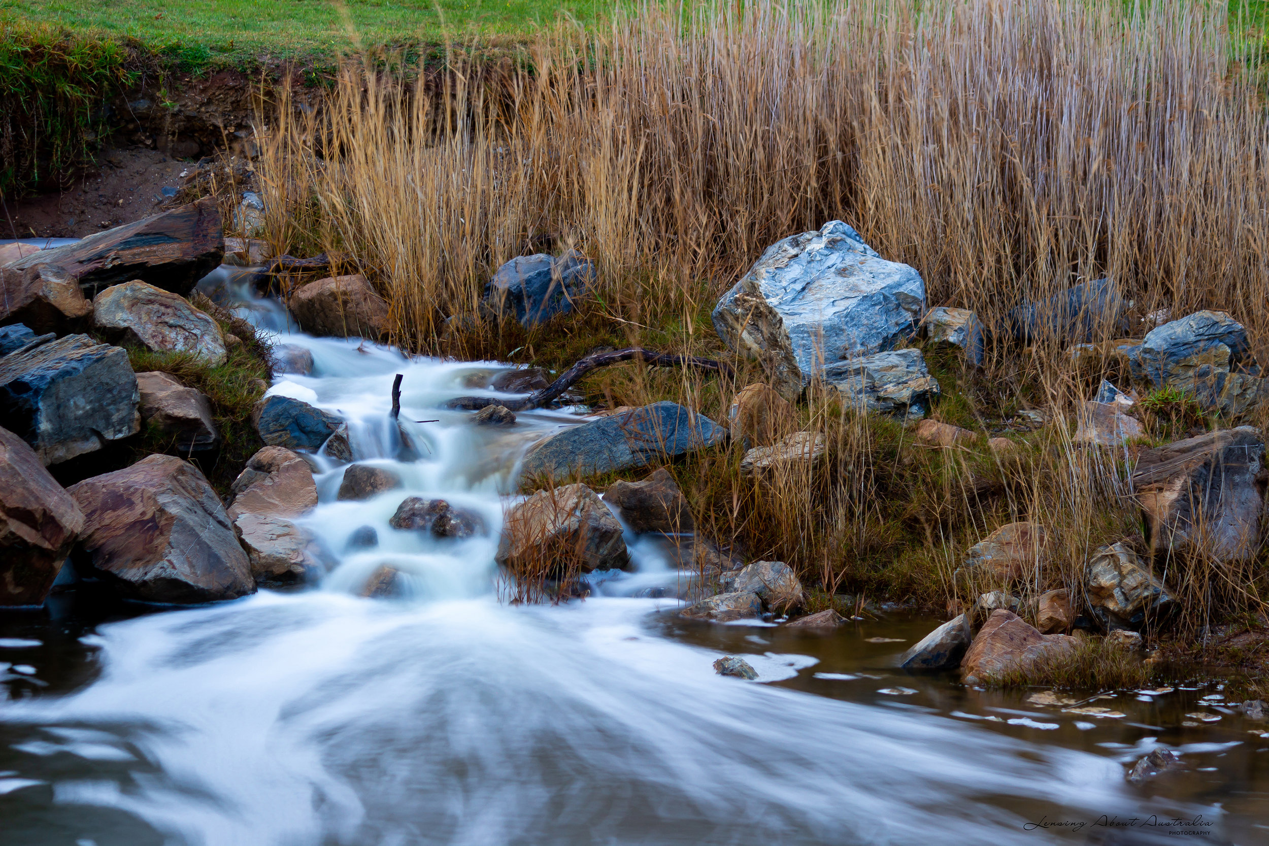 Slow shutter speed  of 4sec; f4.5; ISO 100. The slow shutter speed smooths out the water giving it more of a soft cloudy like appearance.