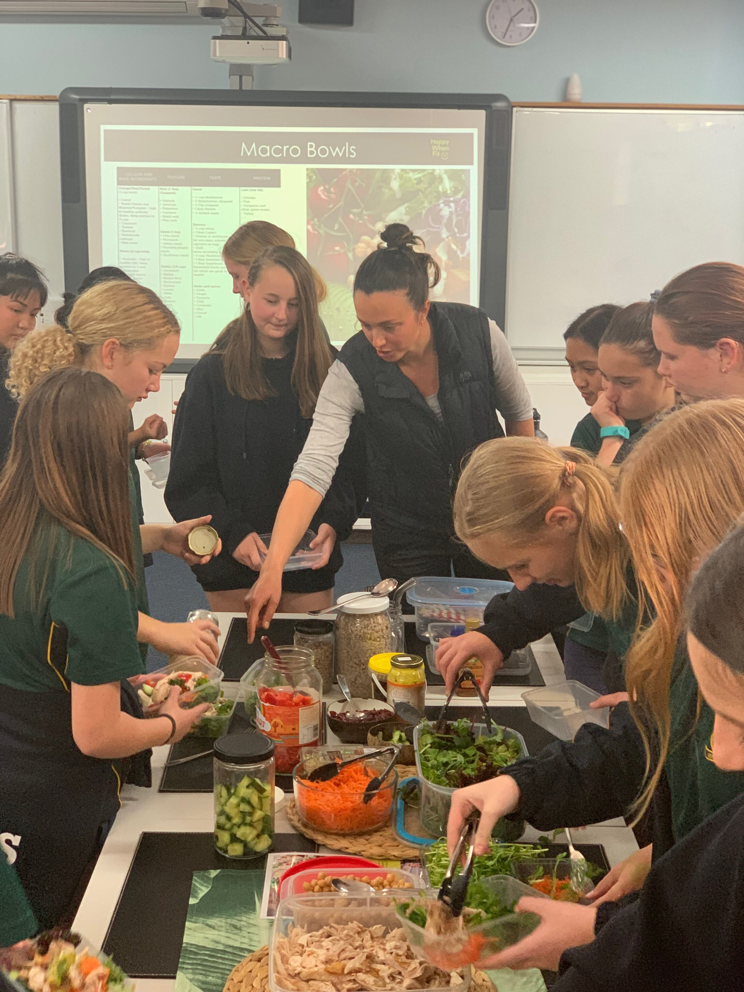 The Year 8 students of Harvey Highschool creating their Macro Bowls. Learning how to balance macro nutrient portions is a big part of the 3 week program.
