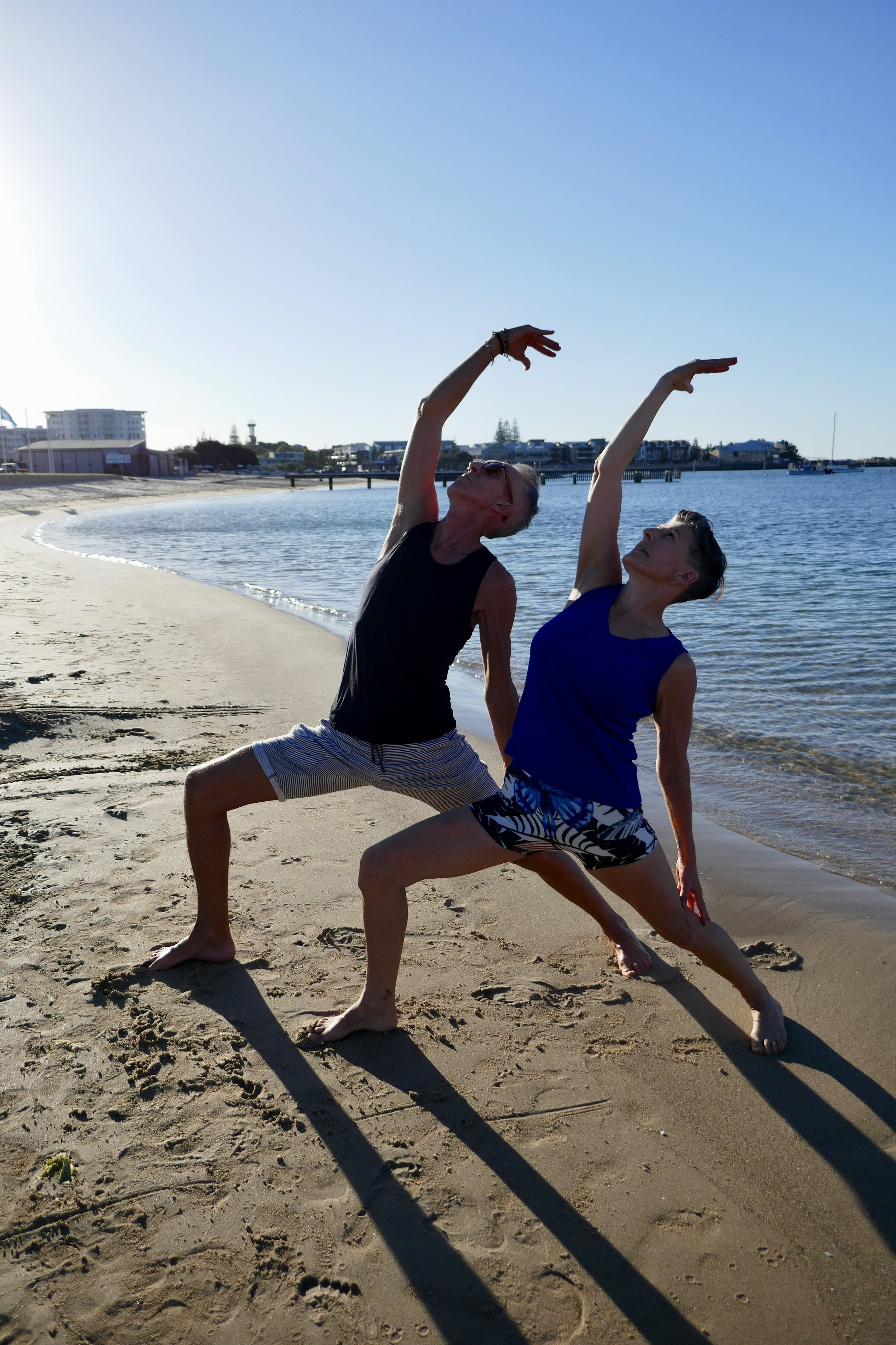 Donelle and John practising Yoga on the beach in Bunbury