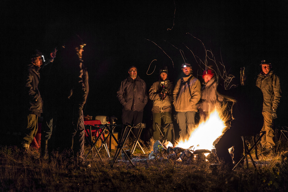 Standing by the camp fire. Photo: Marcus Westberg